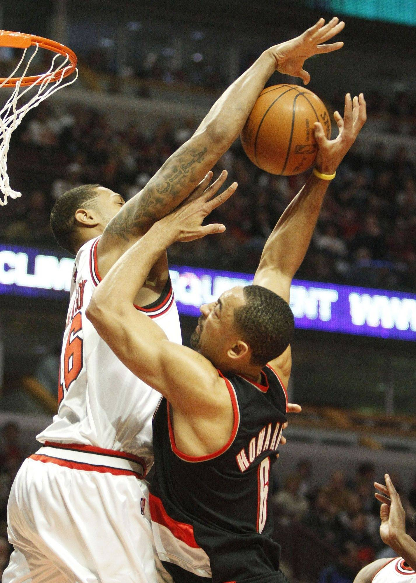 James Johnson of the Bulls blocks the shot of the Portland Trailblazers' Juwan Howard in Friday's game. Johnson and new Bull Joe Alexander are battling for playing time.
