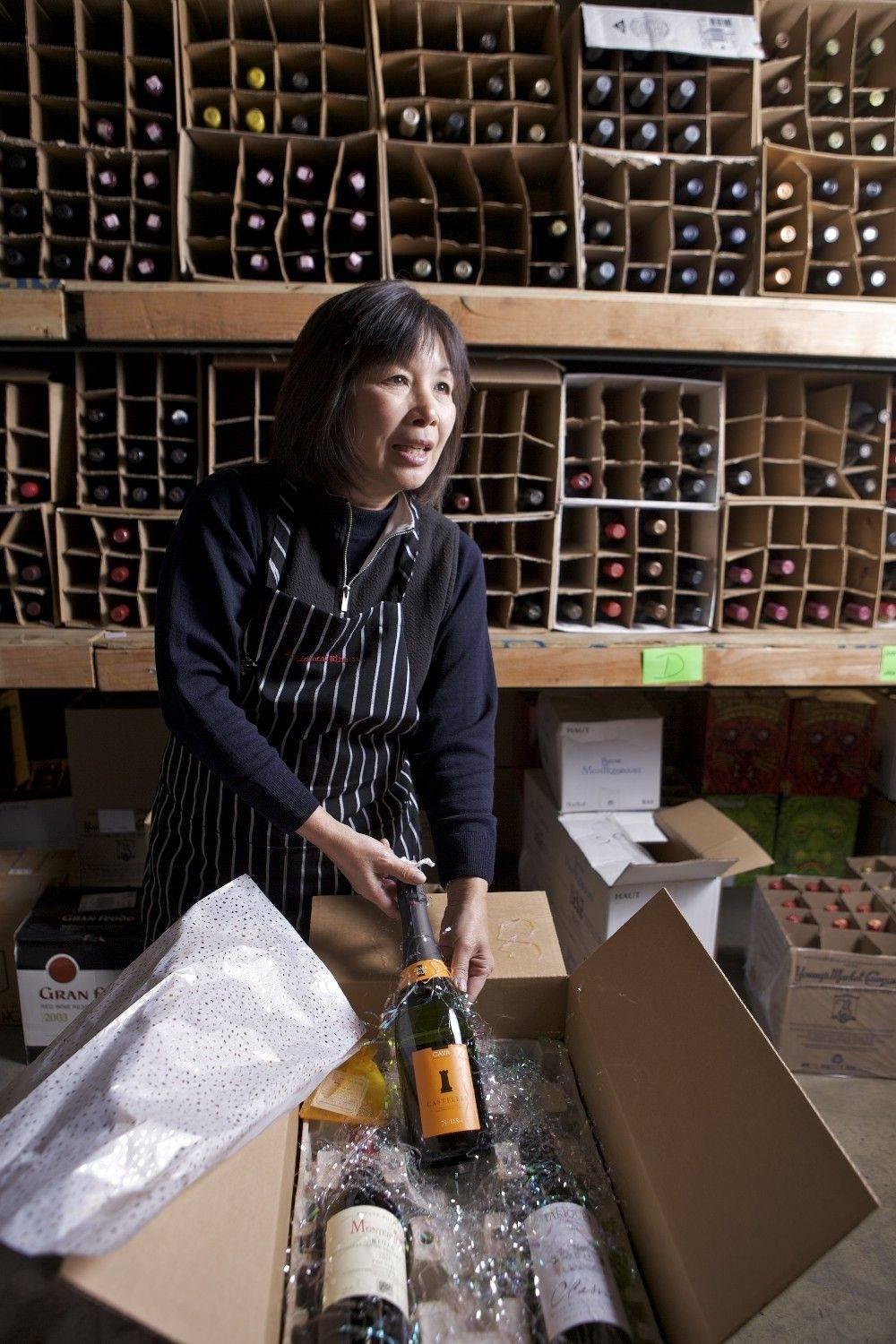"Accidental Wine founder Janice Lee, the ""Master Imbiber,"" fills online wine orders at the Accidental Wine warehouse in Los Angeles."