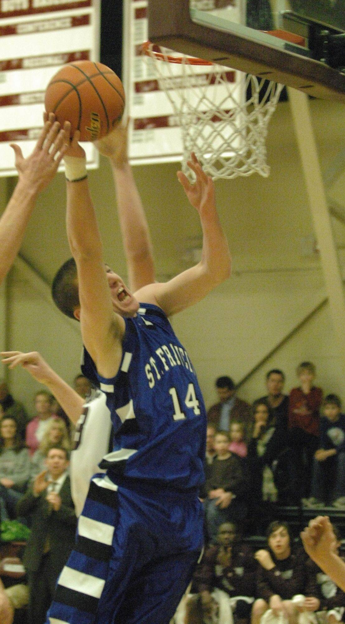 Ryan Coyle of St. Francis goes to the hoop against Wheaton Academy.
