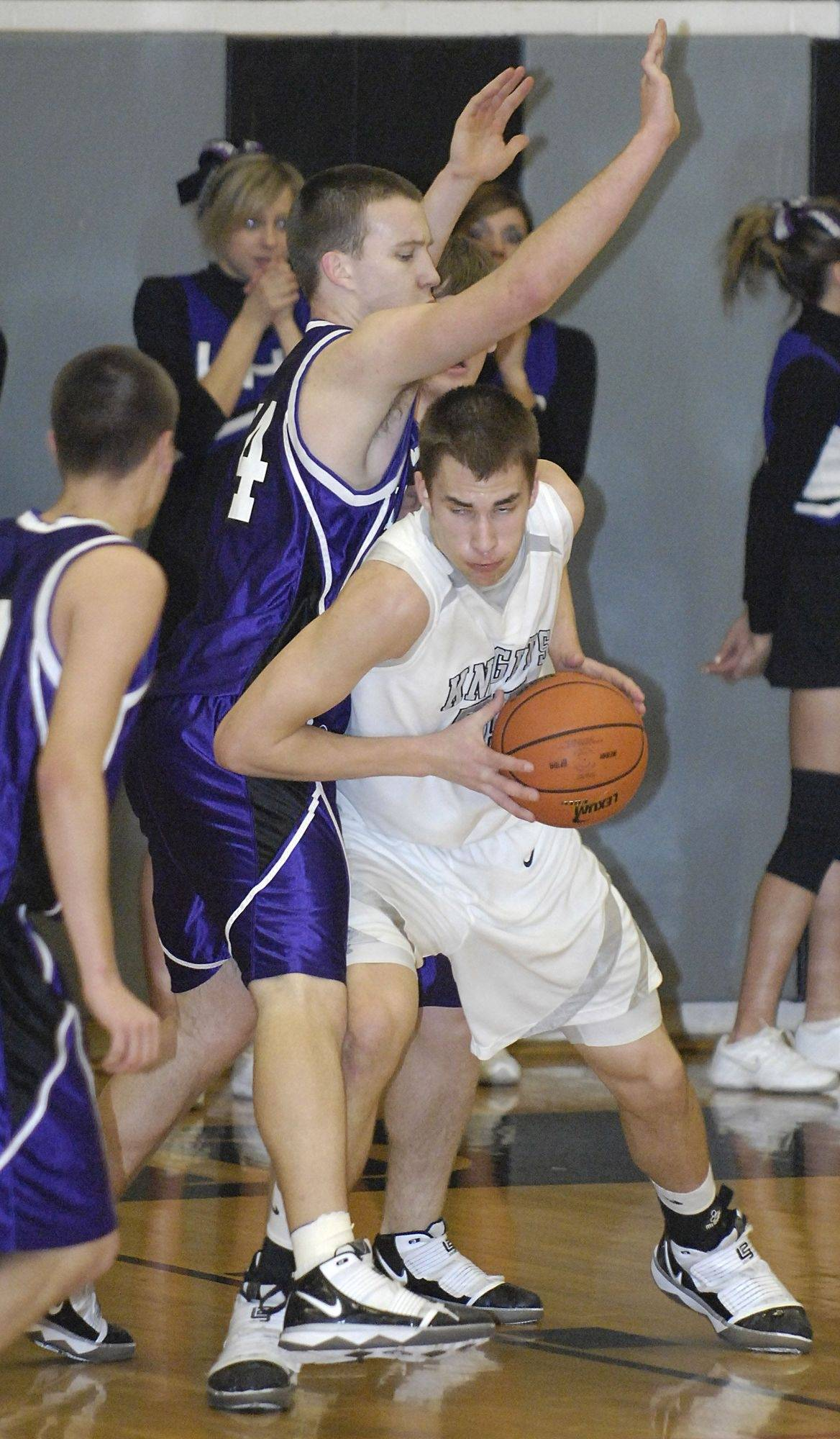 Kaneland's Dave Dudzinski ducks around Hampshire's Ryan Burke.