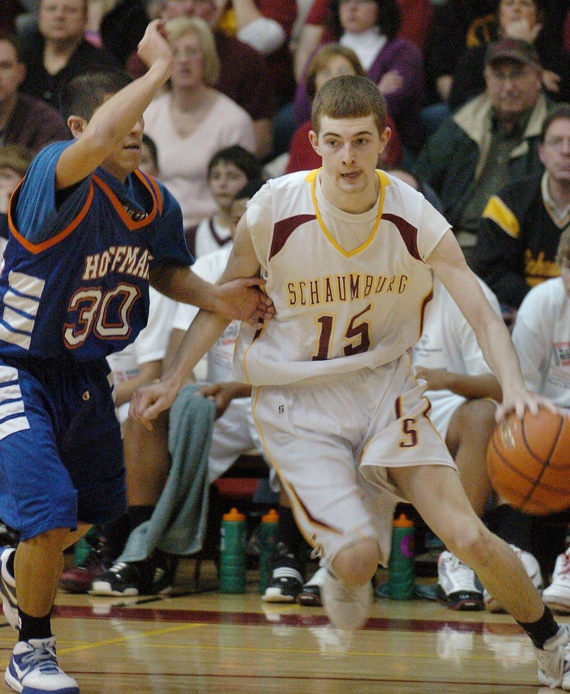 Schaumburg's Glenn Frost drives to the basket against Hoffman Estates.