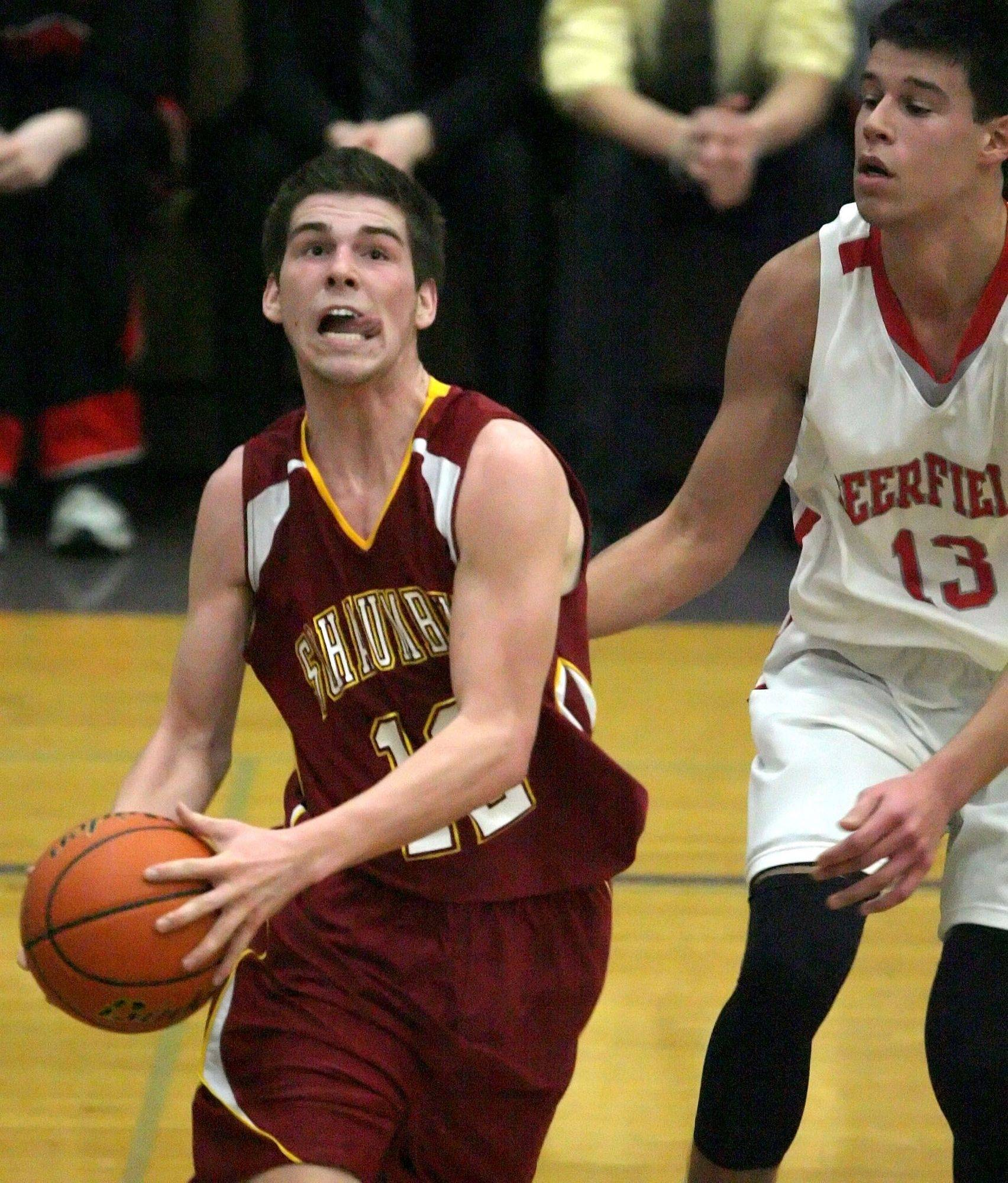 Schaumburg's Declan Geraghty, left, drives past Deerfield's Duje Dukan during Schaumburg's 58-48 in the sectional semifinal game Wednesday in Waukegan.