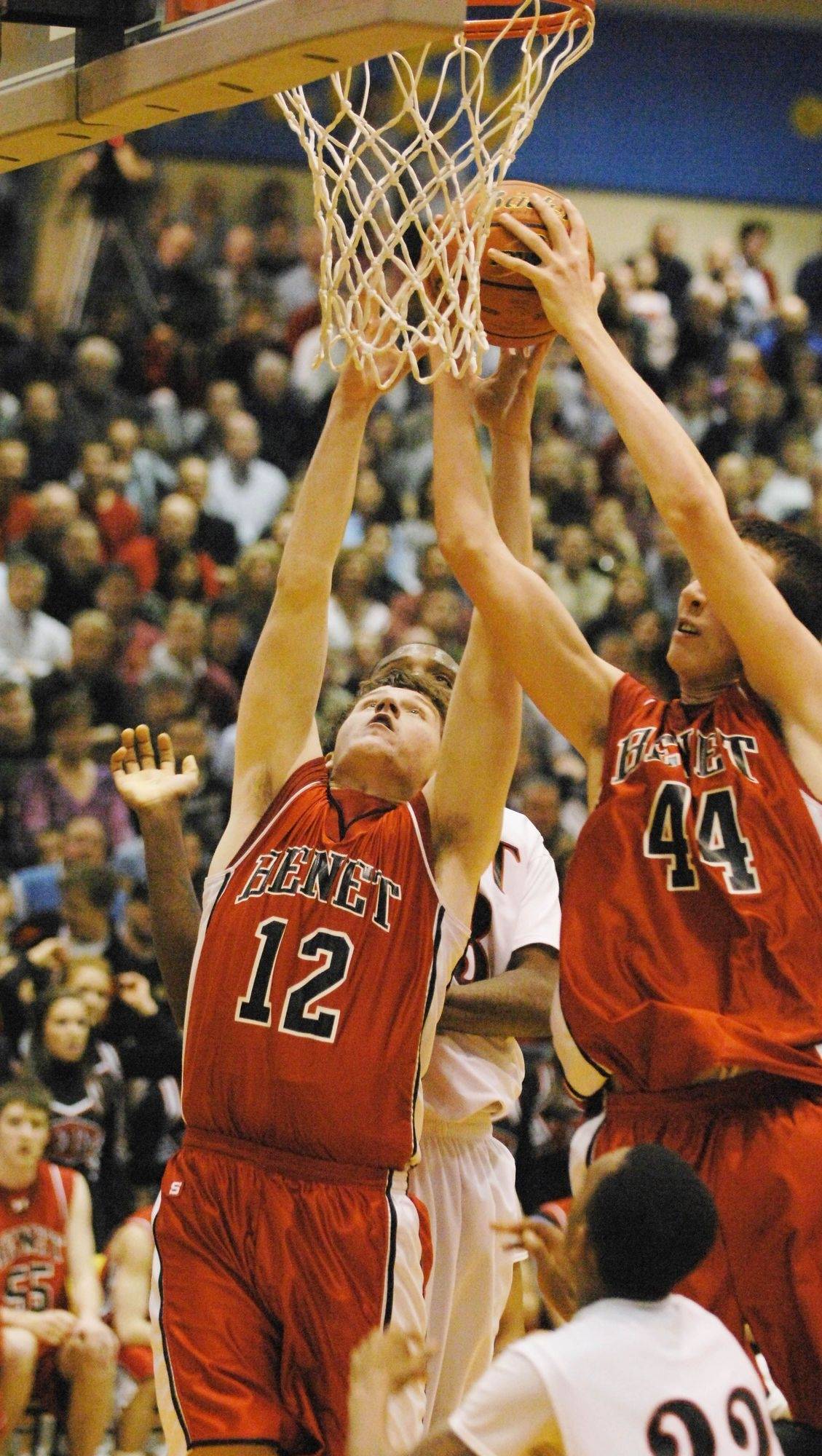 Tim Cramer,left, and Frank Kaminsky of Benet Academy go up for a rebound against East Aurora.