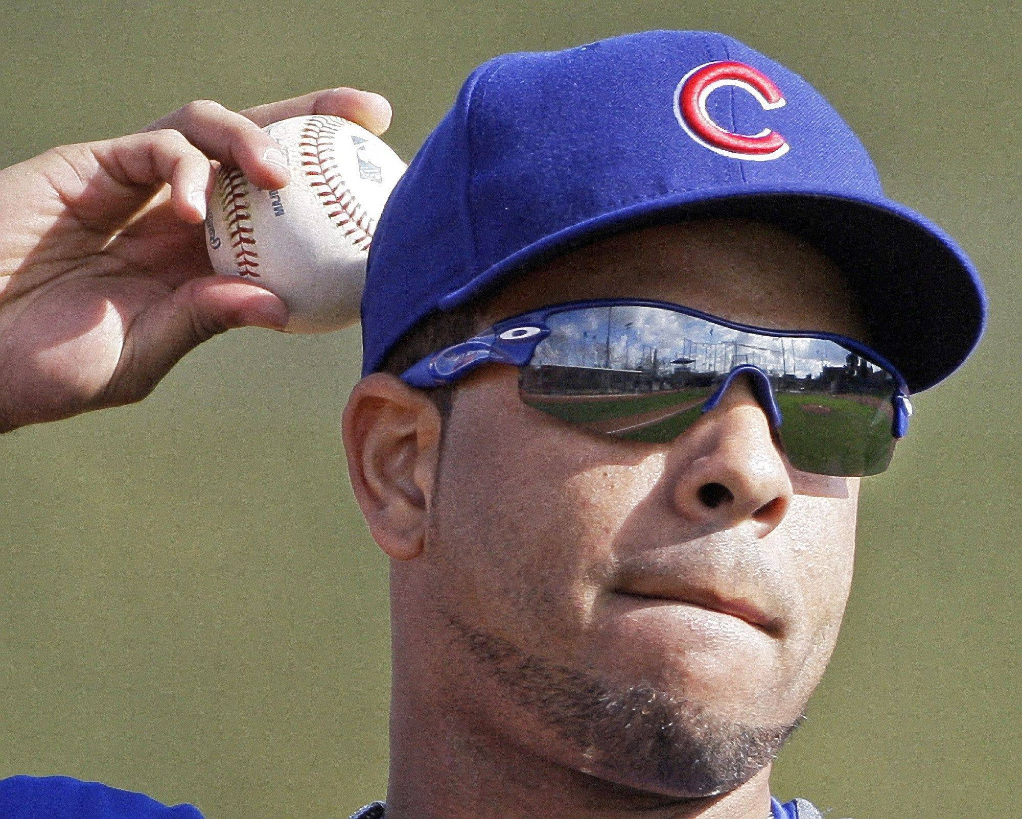 Chicago Cubs' Aramis Ramirez throws a ball during spring training .