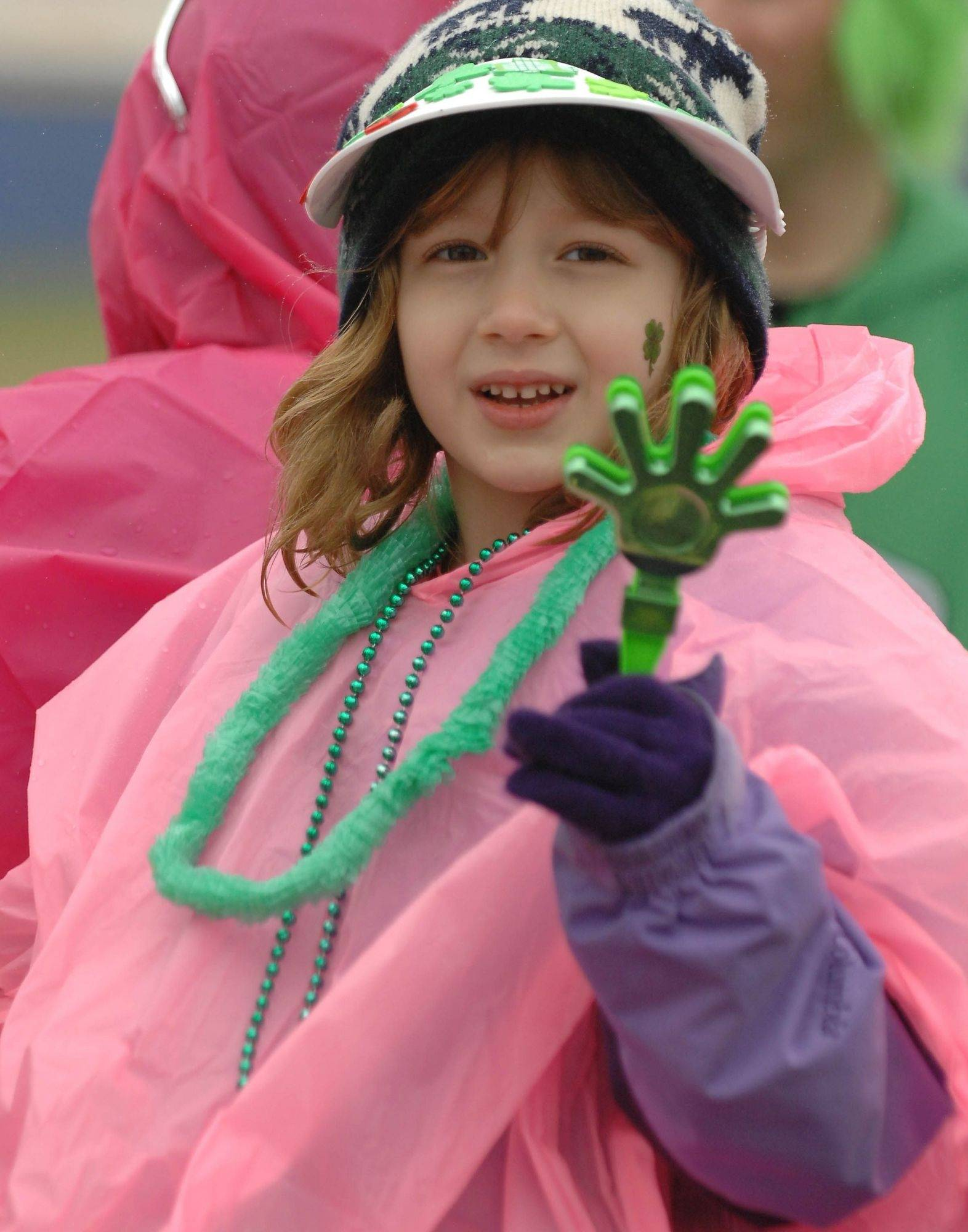 Reganne Nash, 5, of Glen Ellyn makes some noise with a hand clapper Saturday during the West Suburban Irish St. Patrick's Day Parade in Naperville.