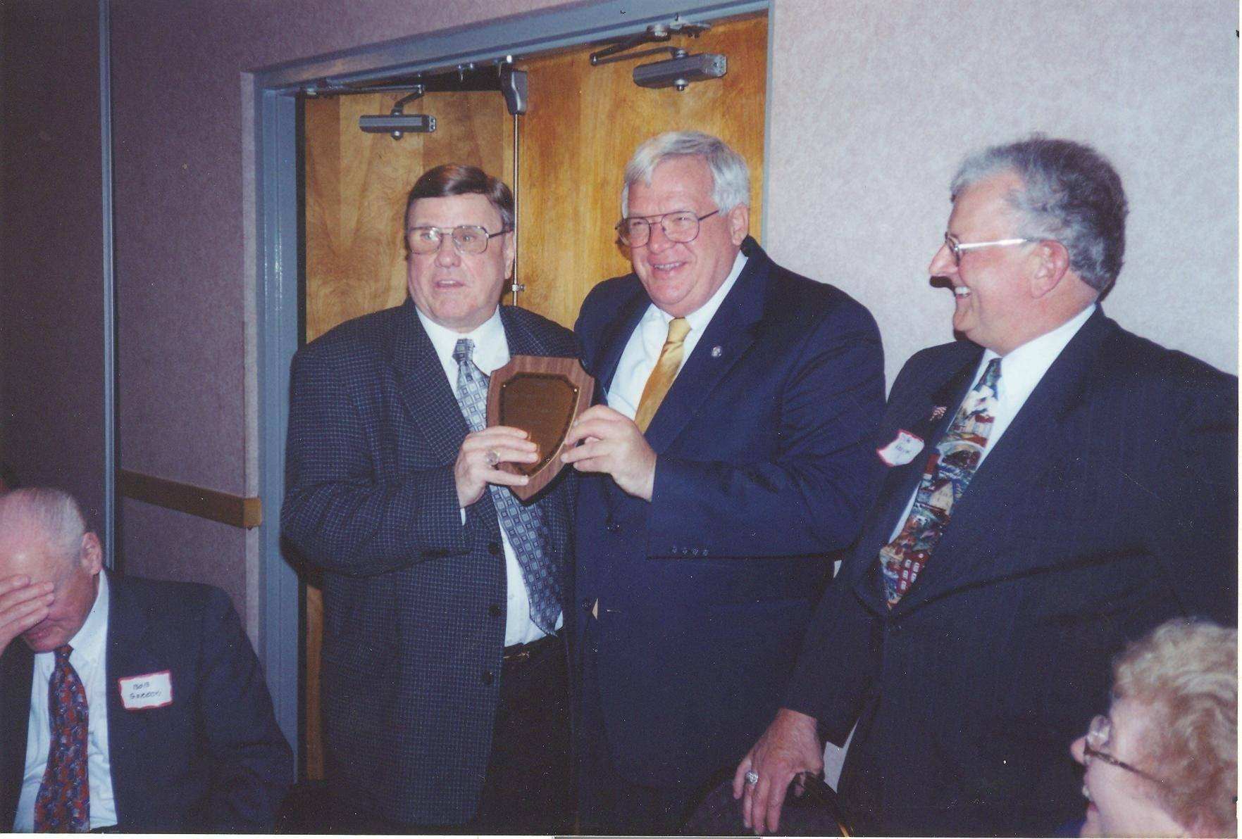 Retired Judge Donald T. Anderson, left, presents U.S. Rep. Dennis Hastert with a plaque at a John Ericsson Republican League gathering.