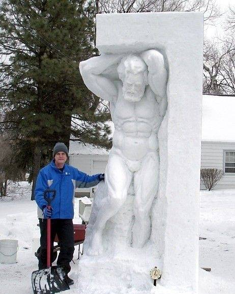 "Snow sculptor Fran Volz works on one of his more magnificent creations. His sculptures are ""a way of sharing with everyone what I feel inside,"" he says."