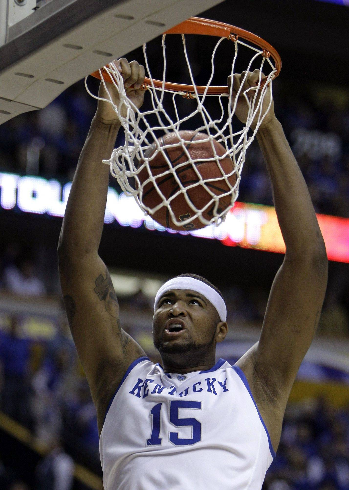Freshman forward DeMarcus Cousins helped Kentucky get to overtime in the SEC title game Sunday, and guard John Wall led the Wildcats to victory.