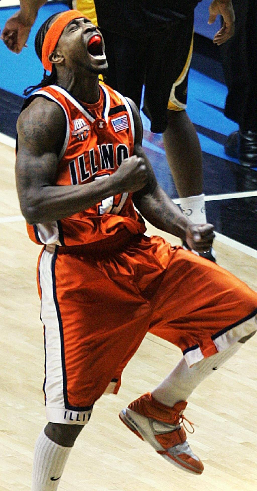 Illinois' Dee Brown howls with delight after draining one of his five three pointers against Wisconsin-Milwaukee at the Allstate Arena in the third round of the NCAA Tournament.