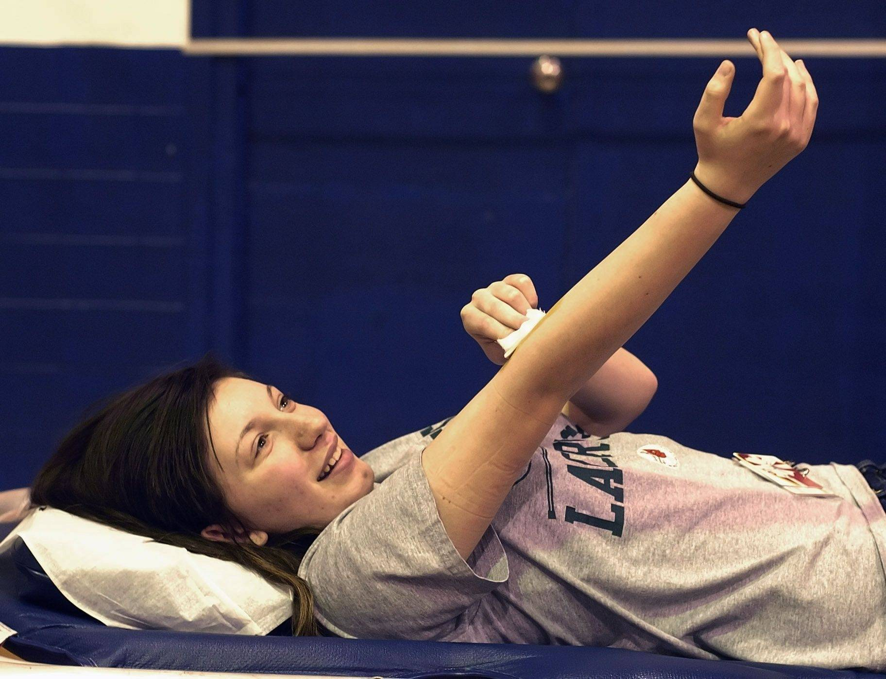 Vicky Ralph of Bensenville gives blood for the first time Wednesday at Fenton High School.
