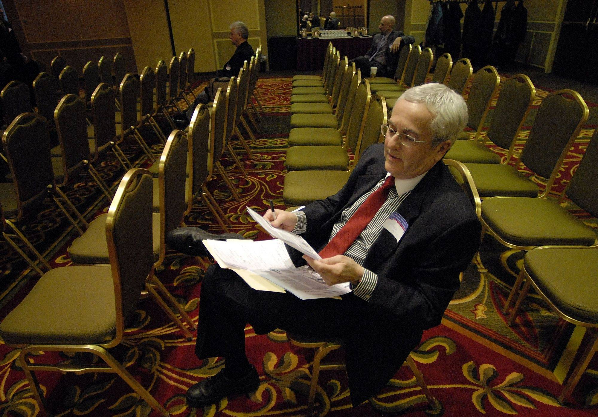 Patrick Patt of Lake Forest looks over his papers before giving a speech.