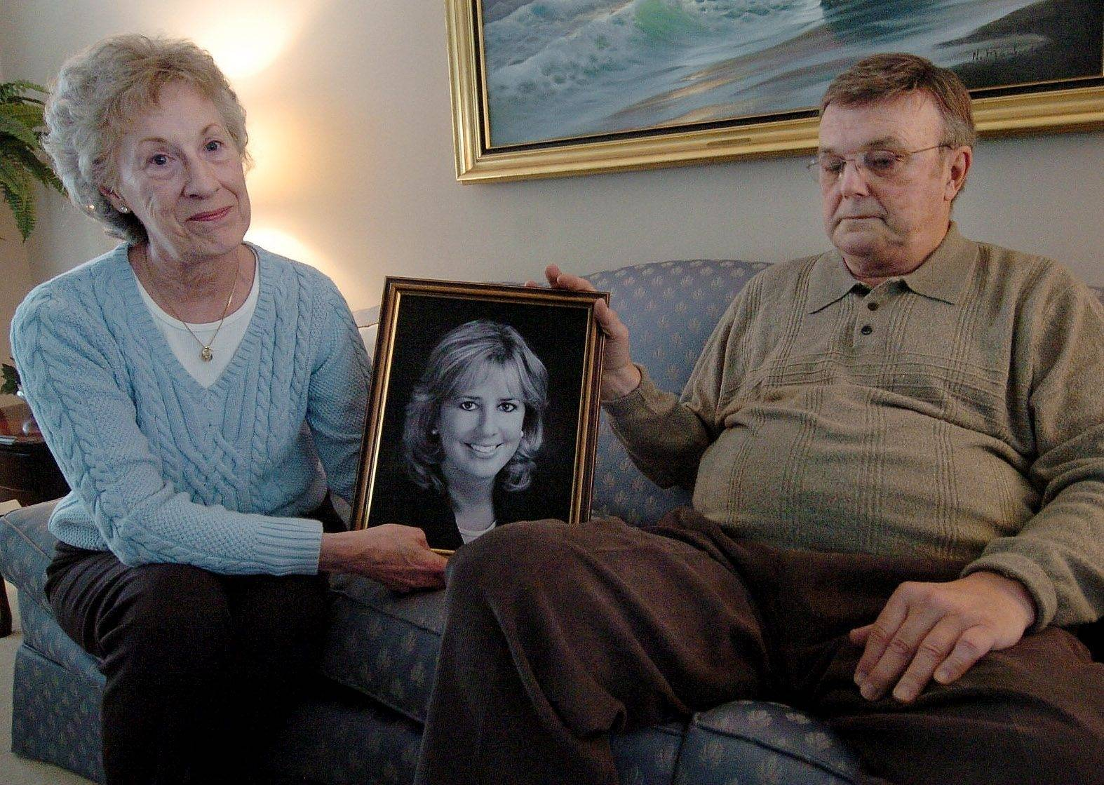 Frank and Barbara Bischof with a portrait of their daughter Cindy.