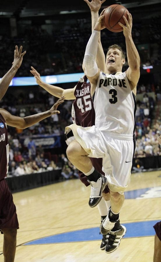 Purdue's Chris Kramer goes in for the game-winning basket past the defense of Texas A&M's Nathan Walkup in overtime.