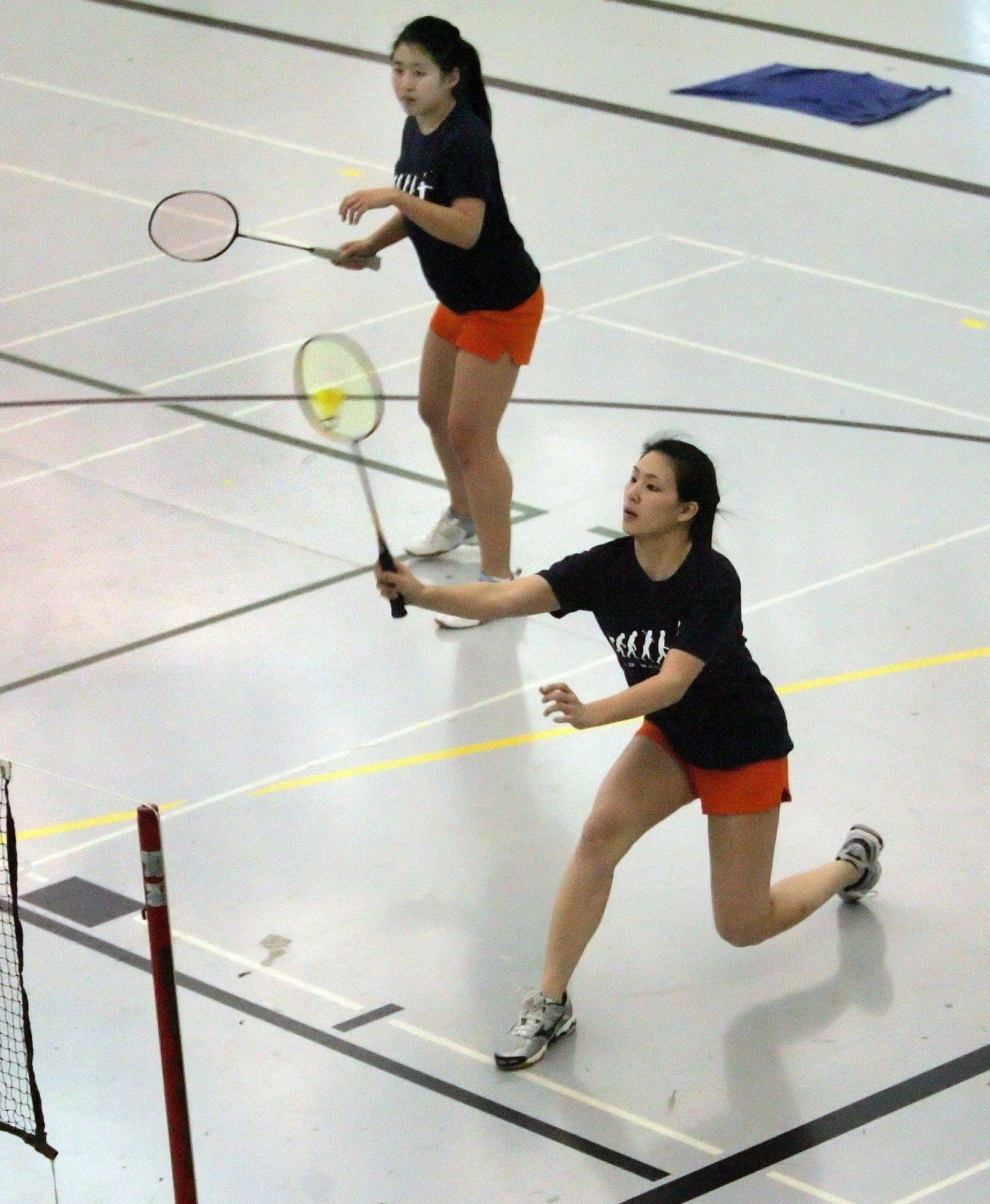 Melissa Chang, left, and Ellen Lin of Naperville North in girls badminton doubles action against Glenbard West in Glen Ellyn on Monday.