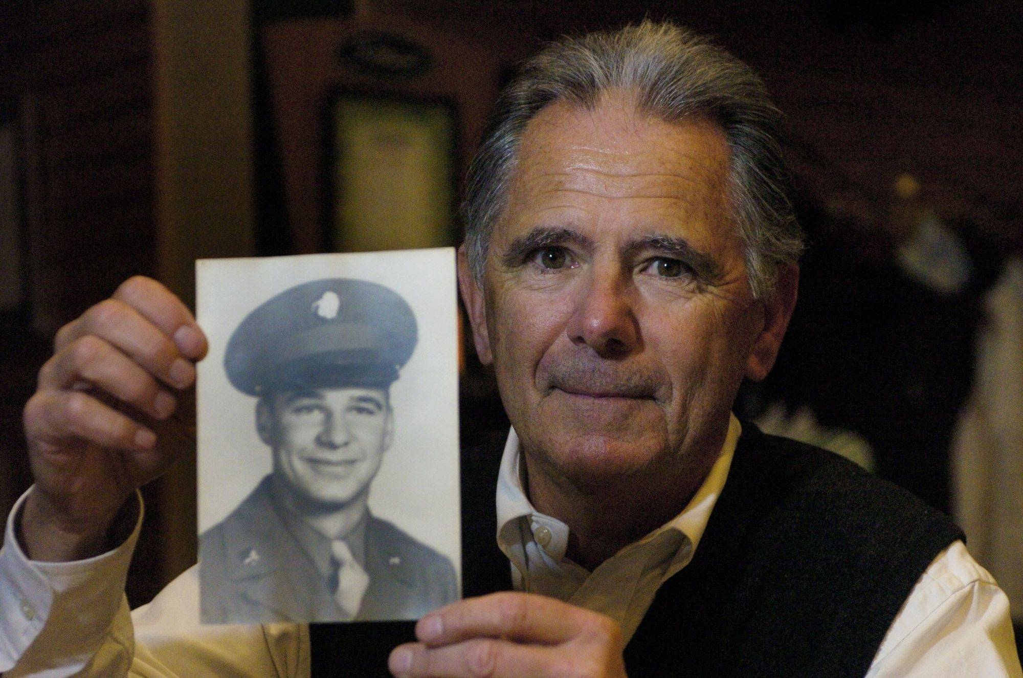 Jim Arendt, the golf pro at Naperville Country Club, with a photo of his brother, Stanley.