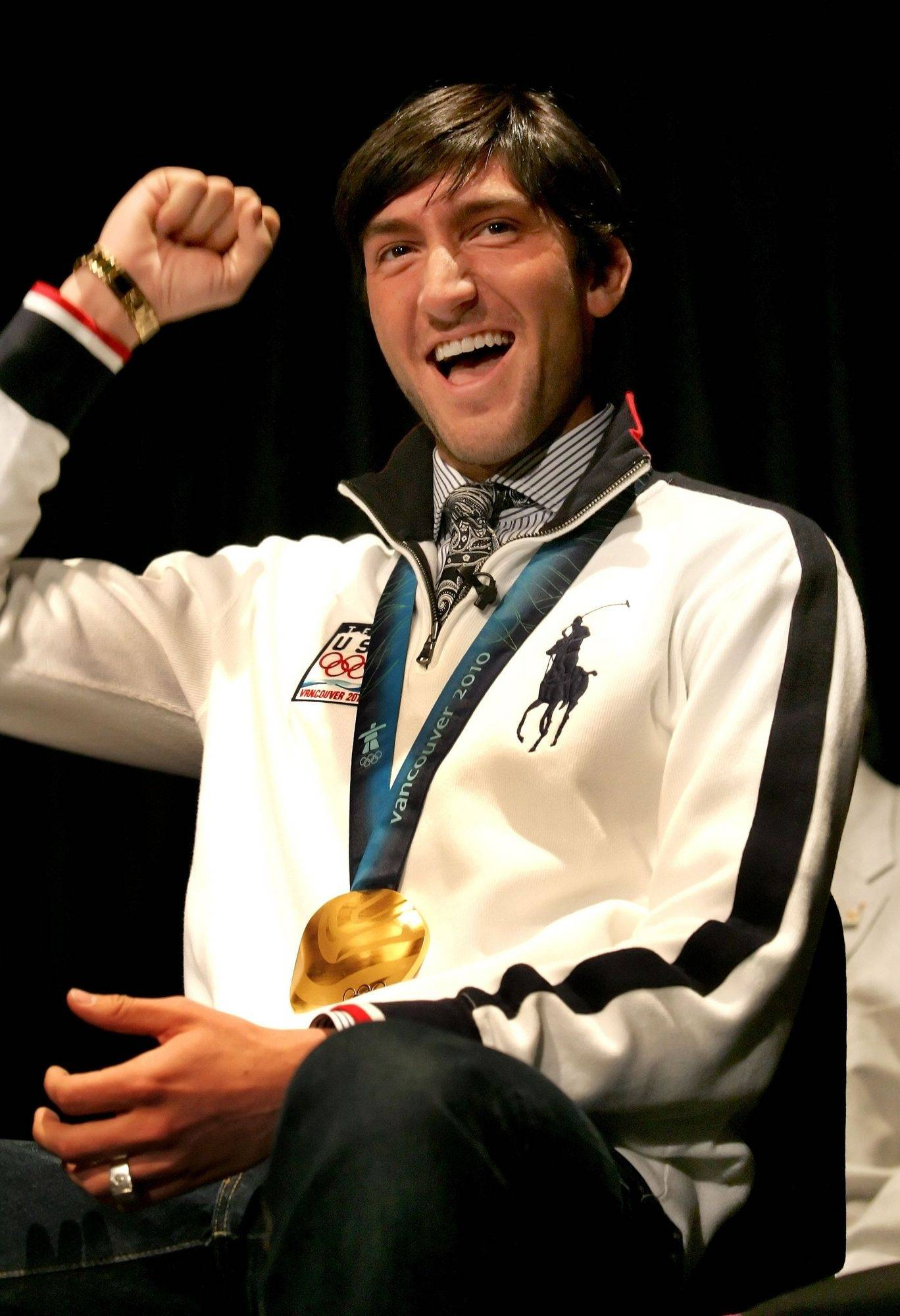 Evan Lysacek reacts to students' cheers as he returns to Neuqua Valley High School in Naperville on Friday.