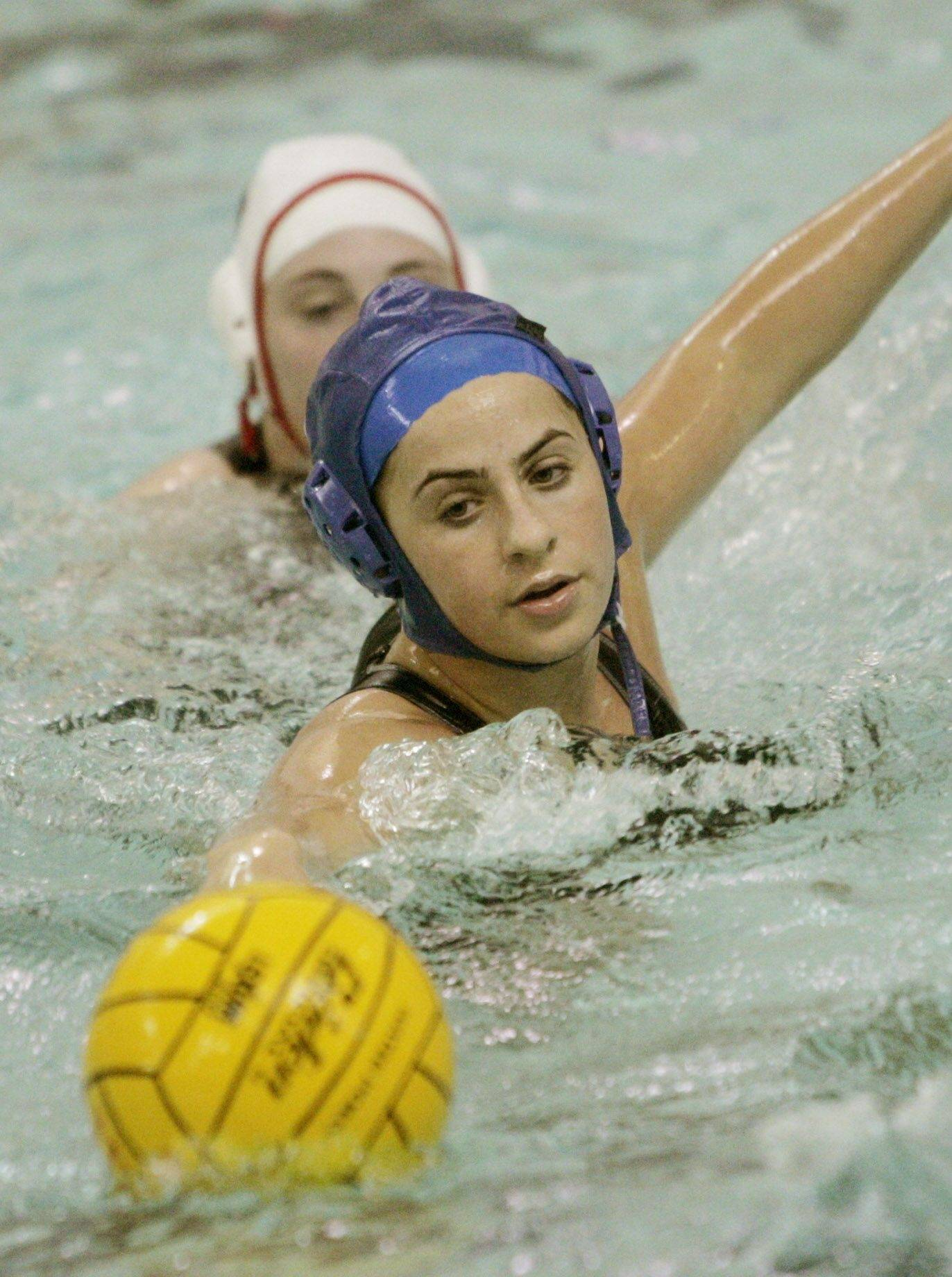 Naperville Central's Laura Vallo chases the ball with Hinsdale Central's Colleen Moran Monday during girls water polo game in Naperville.