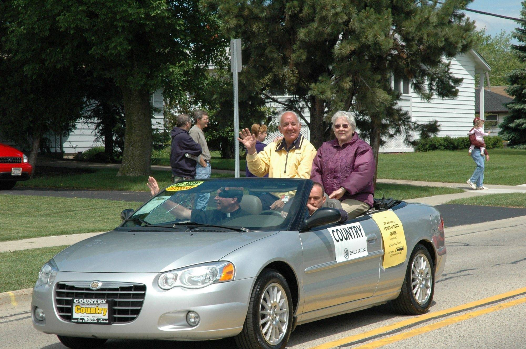 Longtime village of Lindenhurst Treasurer Art Neubauer and his wife Donna ride in the town's 50th Anniversary parade in 2006. Newbauer has been treasurer for almost as long as the village has existed.