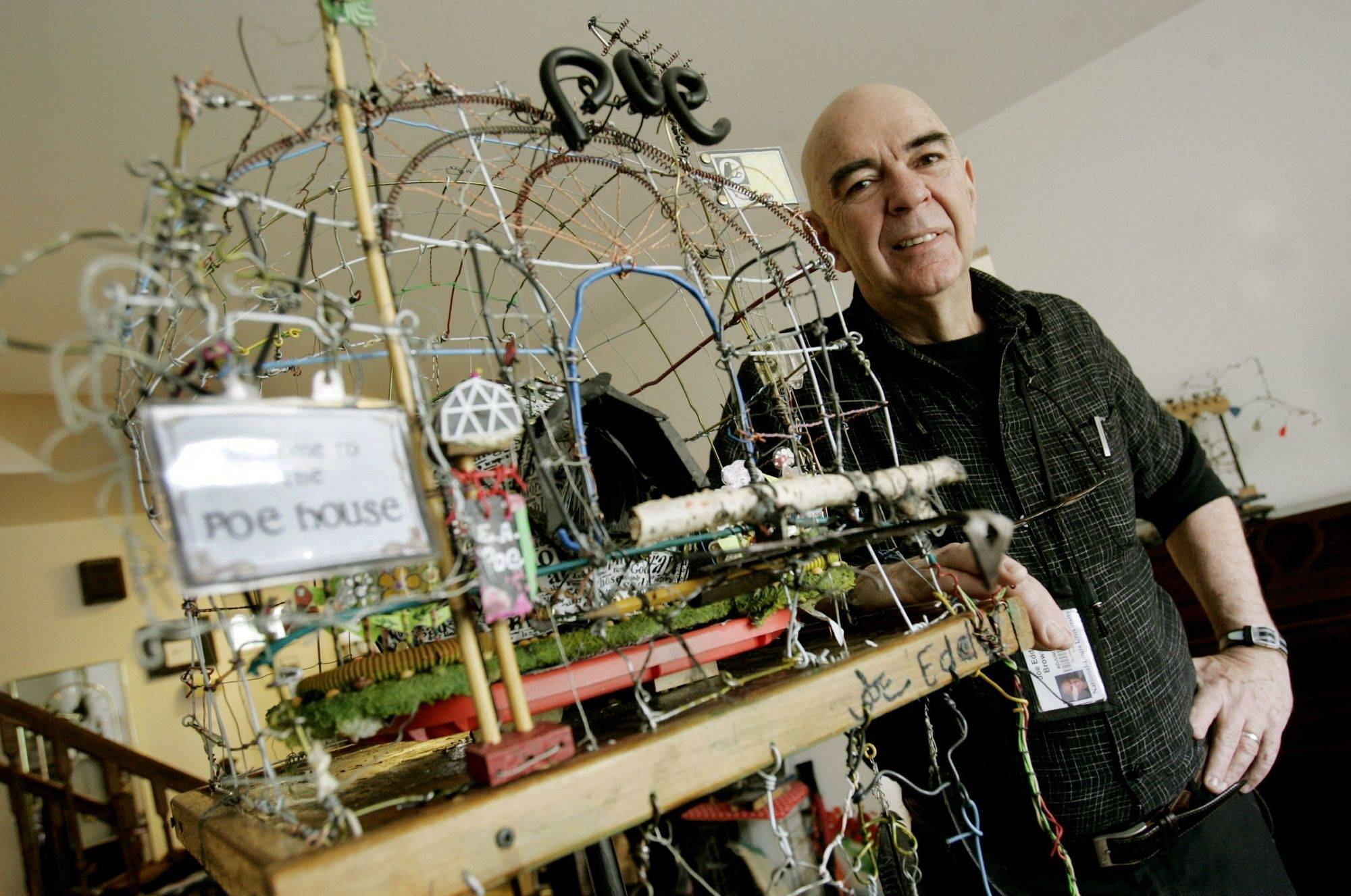 Wheaton artist Joe Eddy Brown shows the bird cage sculpture he will have in a show at the August House Studio in Chicago. The geodesic dome bird cage is made of 42 coat hangers.