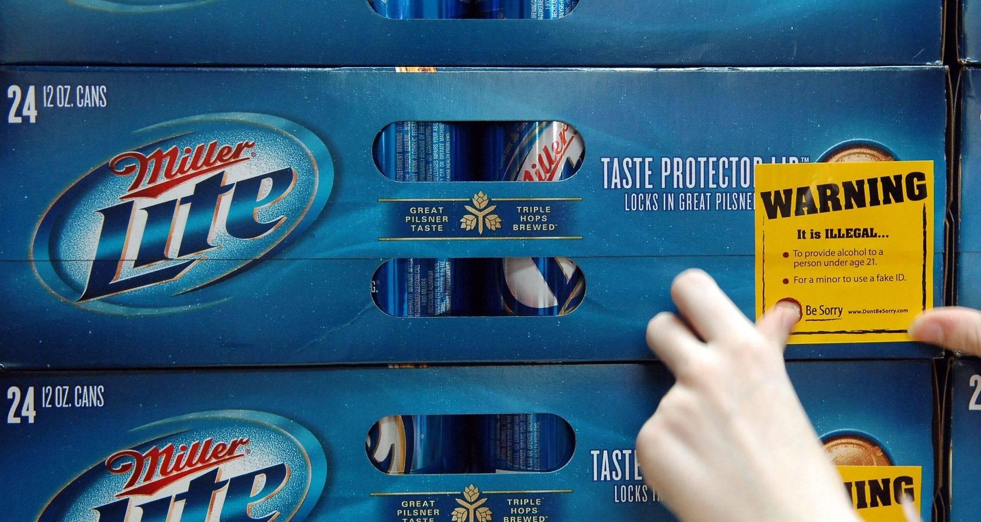 Area high school students were at liquor stores, including Lundeen's Discount Liquors in St. Charles, applying stickers on cases of beer that warn purchasers that it is illegal to provide alcohol to minors.