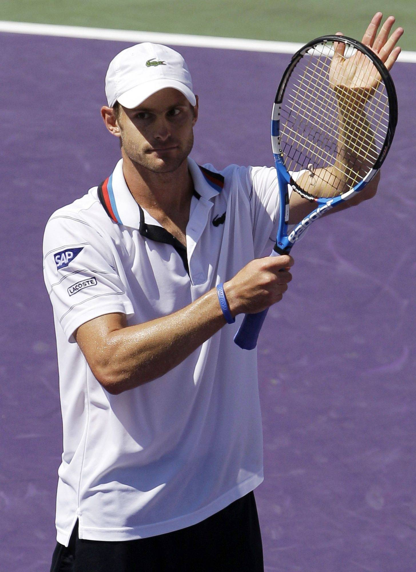 Andy Roddick celebrates after defeating Rafael Nadal 4-6, 6-3, 6-3, in a semifinal match at the Sony Ericsson Open.