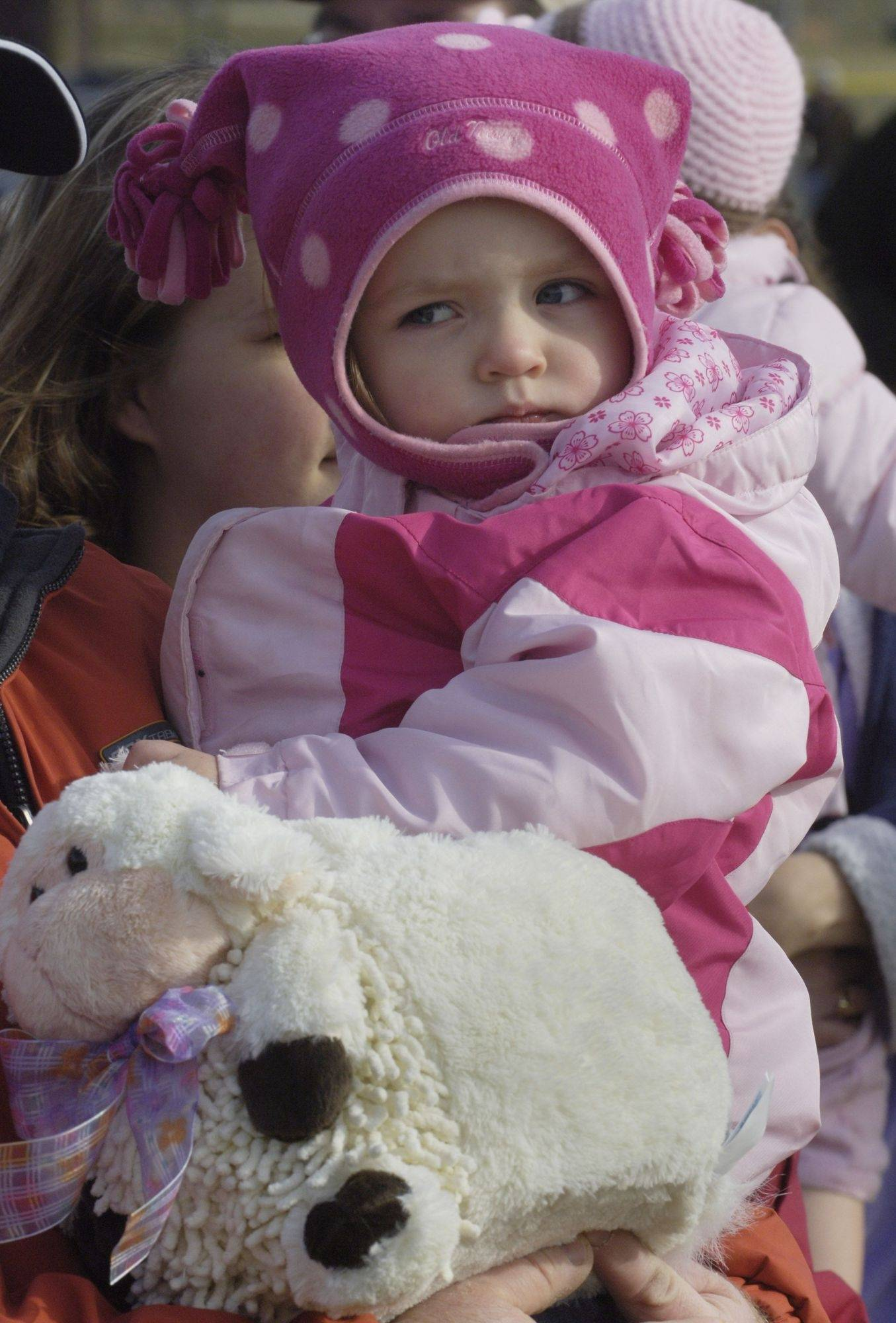 Isabella Mullins, 2, of Wauconda waits for the start of Saturday's annual egg hunt at Cook Park in Wauconda.