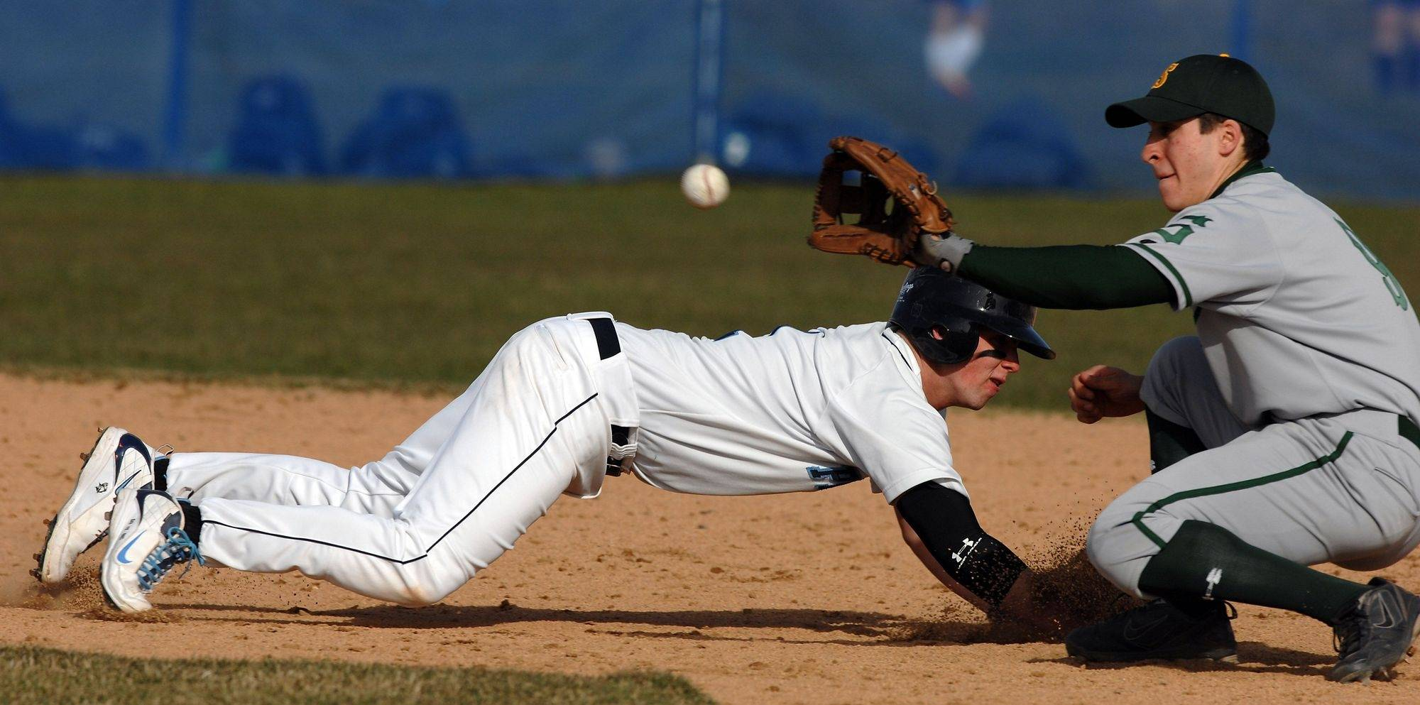 Prospect's Jon Coen slides safely back into second as Stevenson's Kyle Ruchim tries to pick him off in boys baseball game action on Monday at Prospect High School.