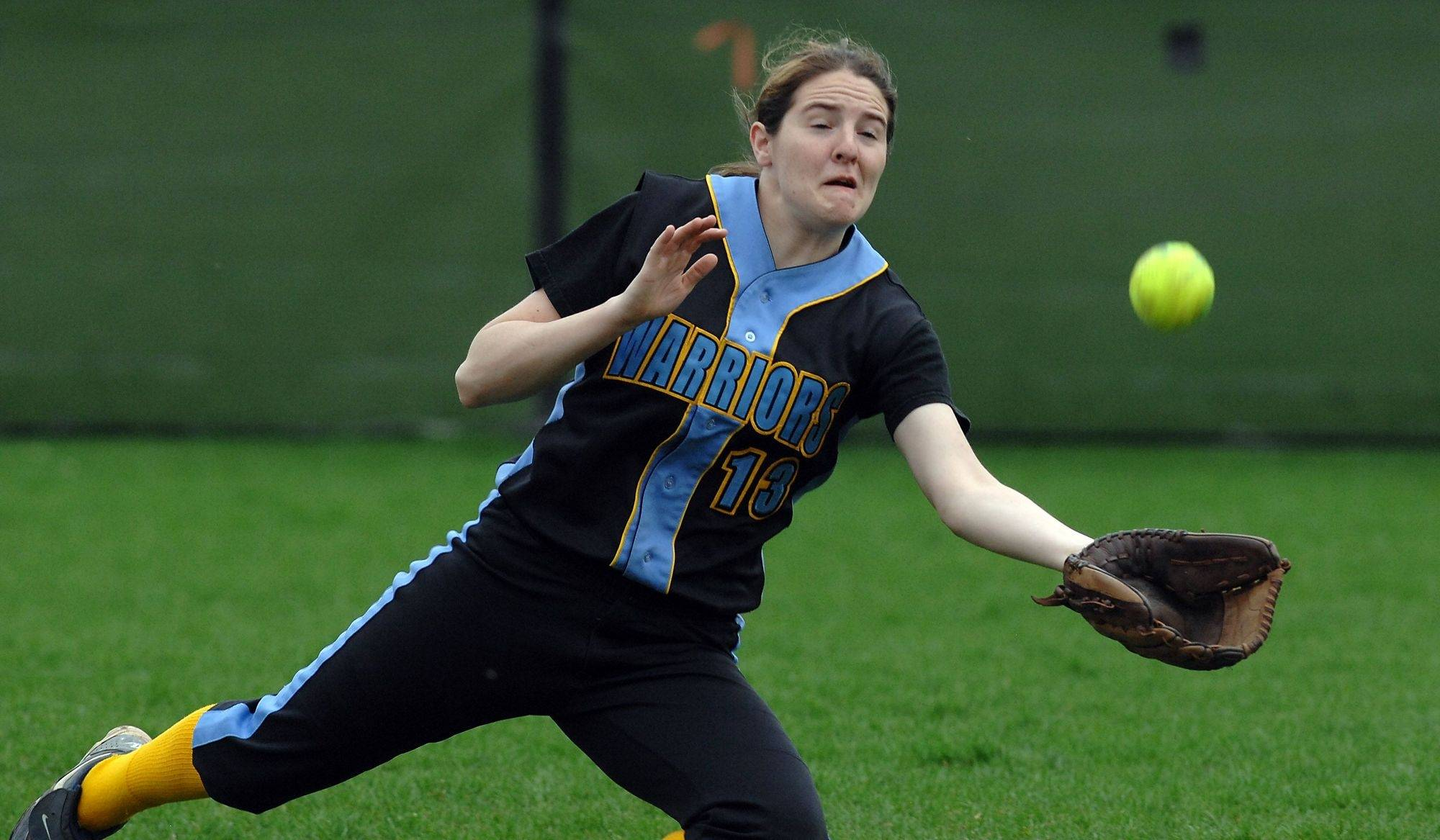 Maine West's Vanessa Bagneschi robs Rolling Meadows player MaryClare Loughery of a hit during the forth inning of on Monday's game at Rolling Meadows High School.