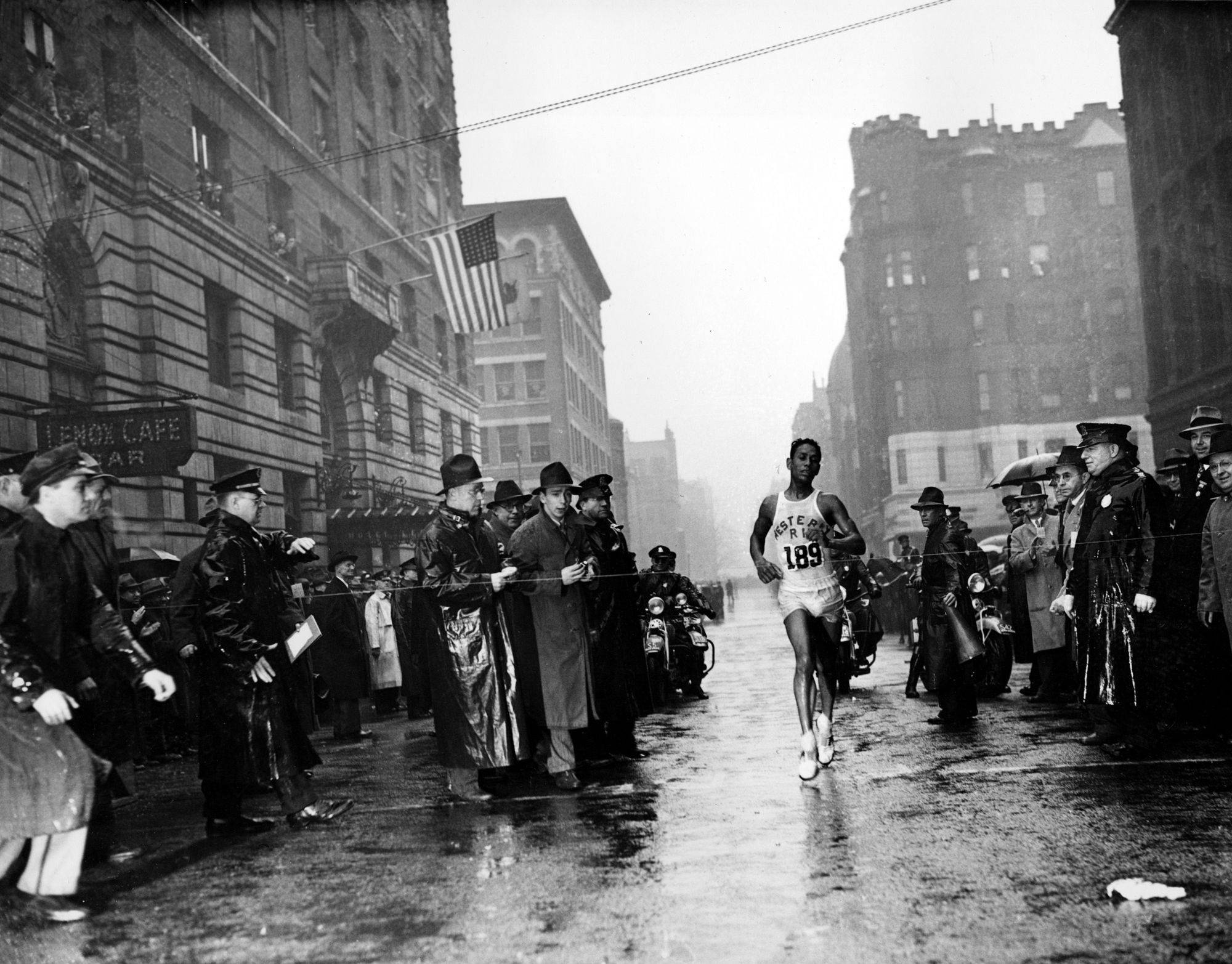 "Ellison M. ""Tarzan"" Brown, from Alton, R.I., crosses the finish line in the 43rd Boston Marathon in downtown Boston, Ma., April 19, 1939. Brown finished the 26 miles, 385 yards in 2 hours, 28 minutes and 51.8 seconds, breaking the marathon world record."