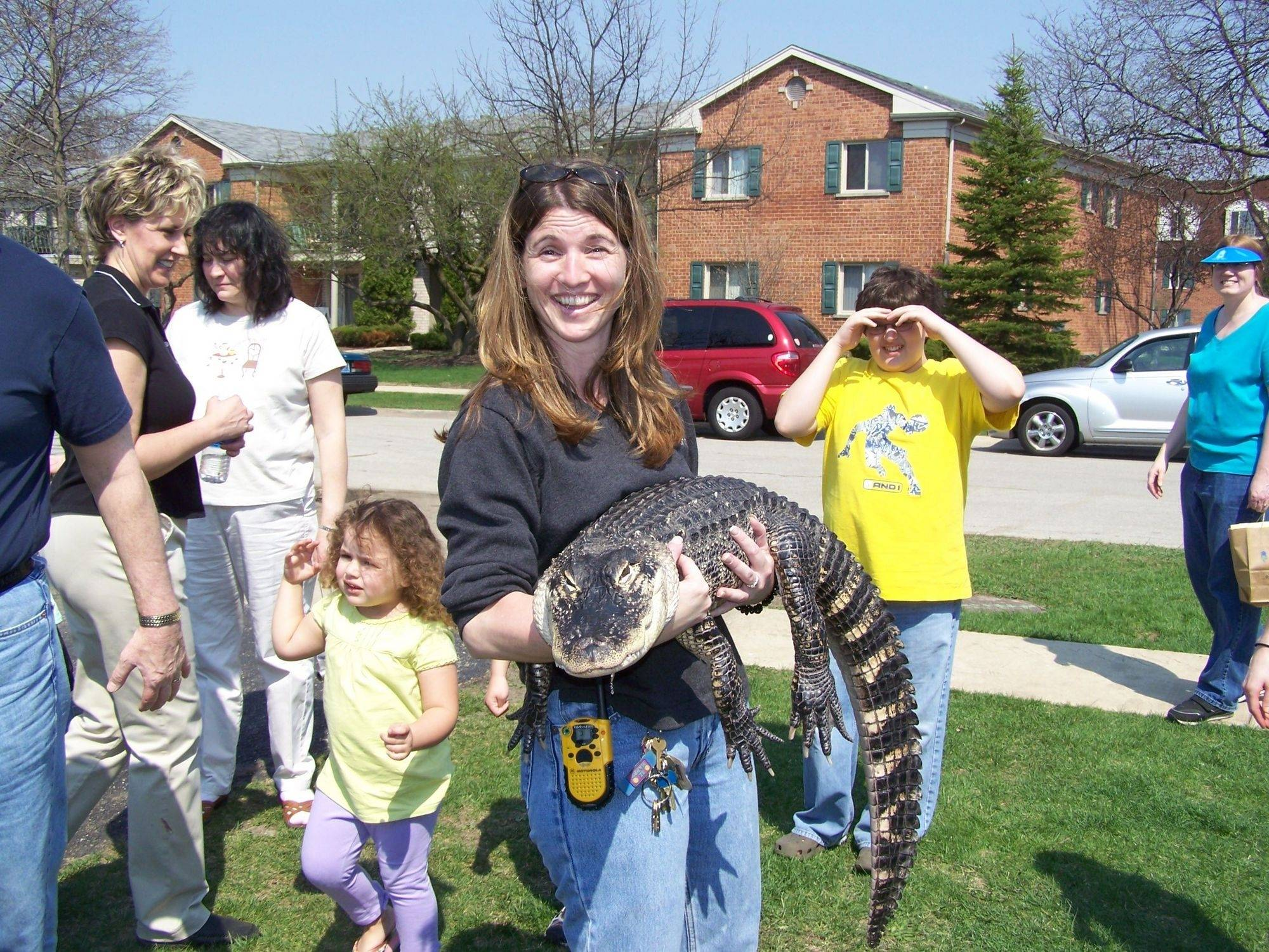 Noreen Newton, Earth Day coordinator for the Elk Grove Park District with an alligator from Jim Nesci's Cold Blooded Creature Show.