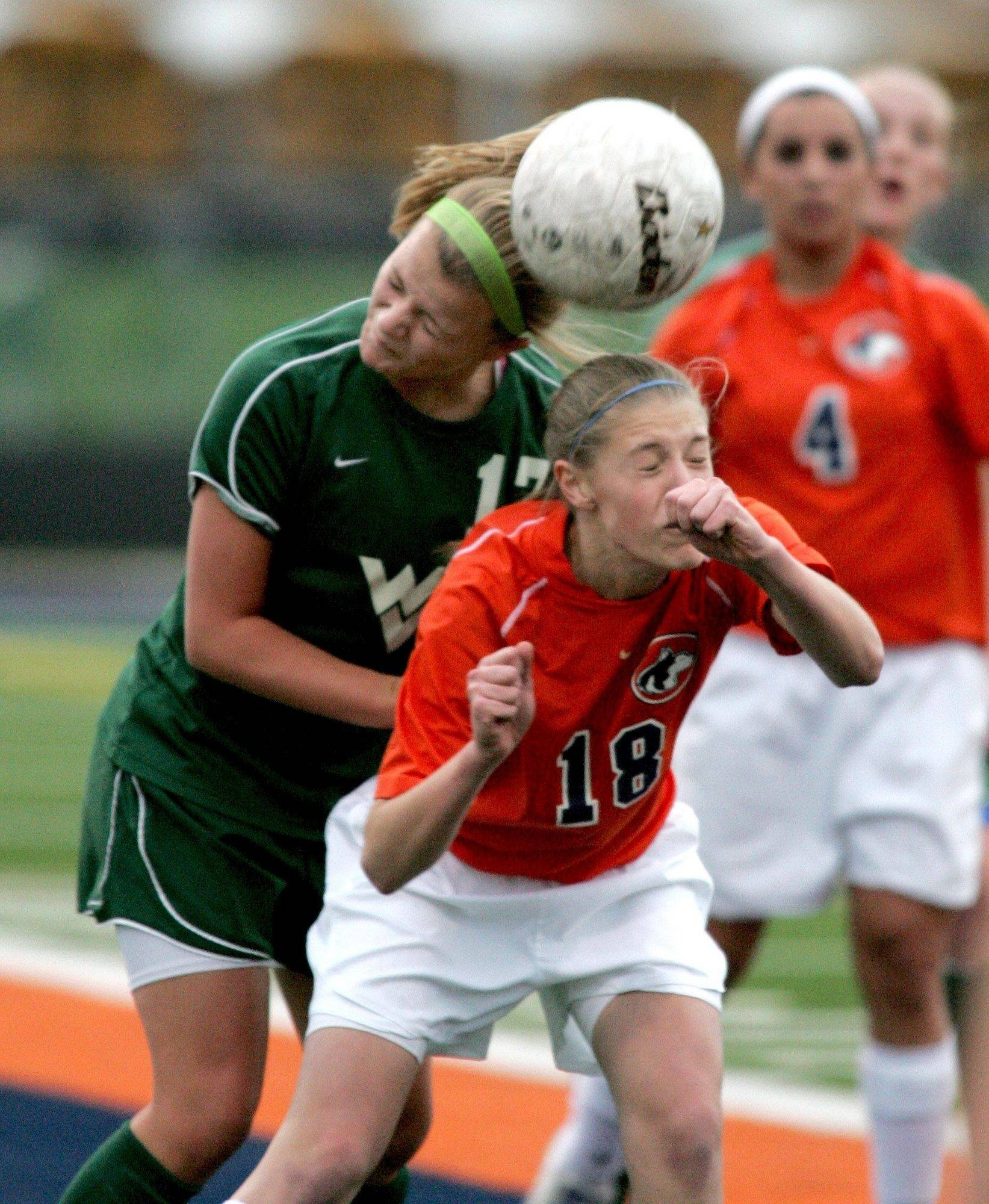 Hannah Klancic of Waubonsie Valley, left, gets the header over Angela Widlacki of Naperville North during girls soccer in Naperville on Monday.