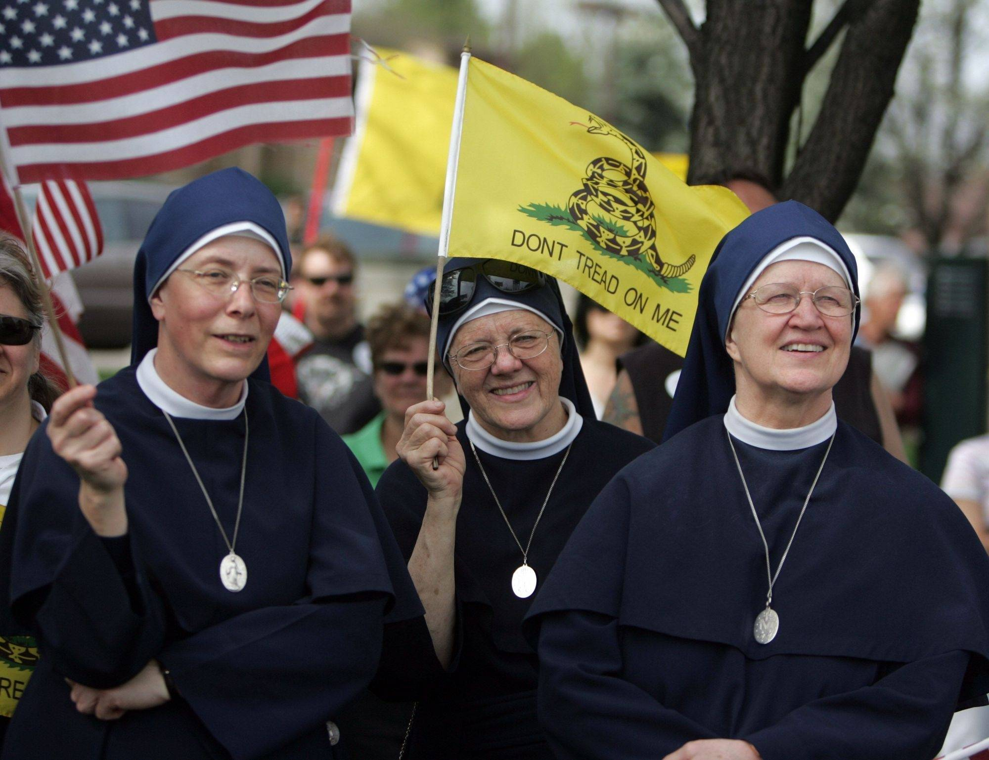 Sister Rose Bernadette, left, Sister John Marie, and Mother Mary Patrick, right, of Libertyville's Daughters of the Immaculata voice their opinion at a recent Tea Party anti-tax rally in Palatine.