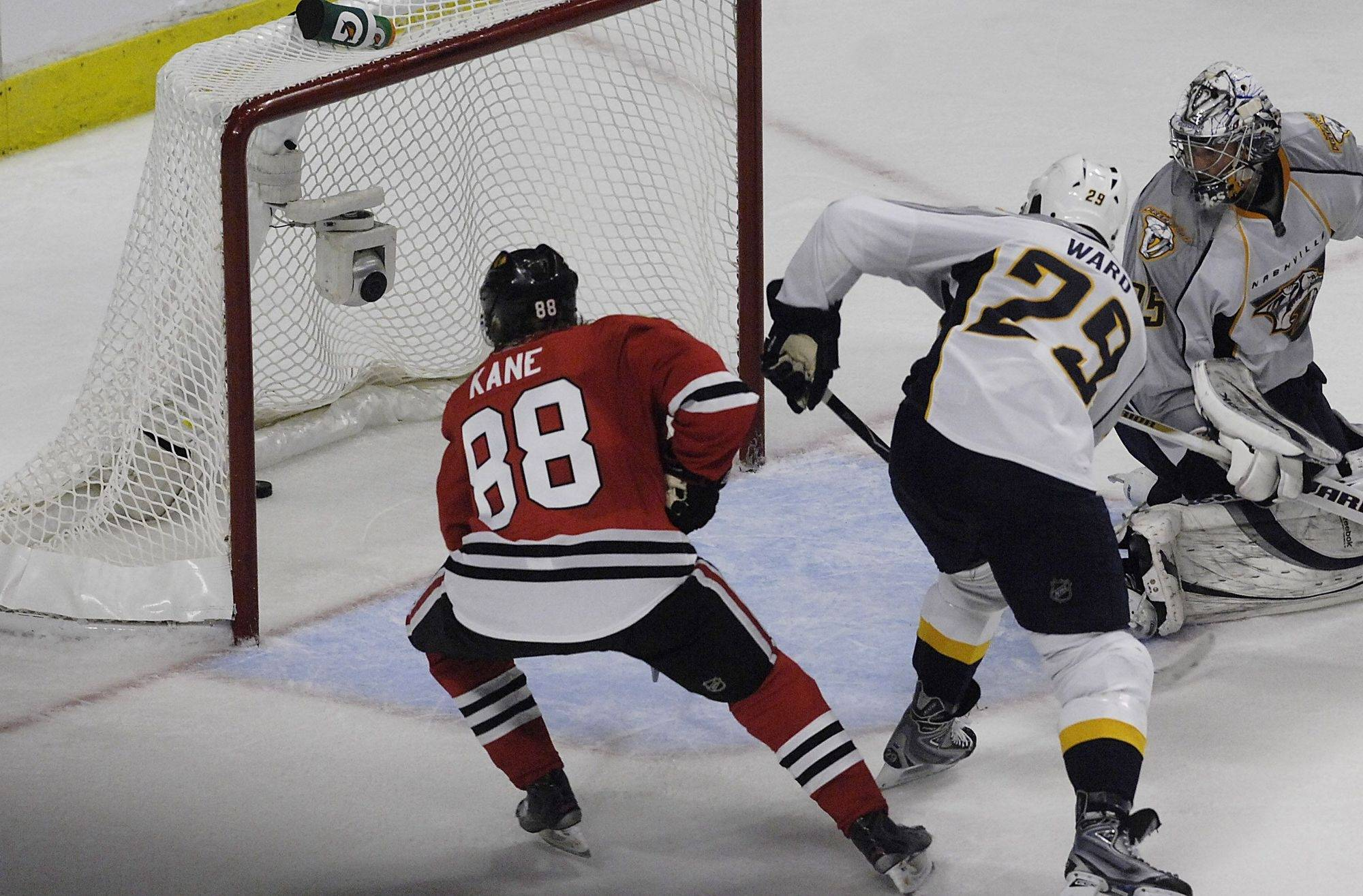Chicago Blackhawks right wing Patrick Kane ties the game at 4 with 13 seconds remaining in regulation Saturday at the United Center in Game 5 of the first-round Stanley Cup playoff series.