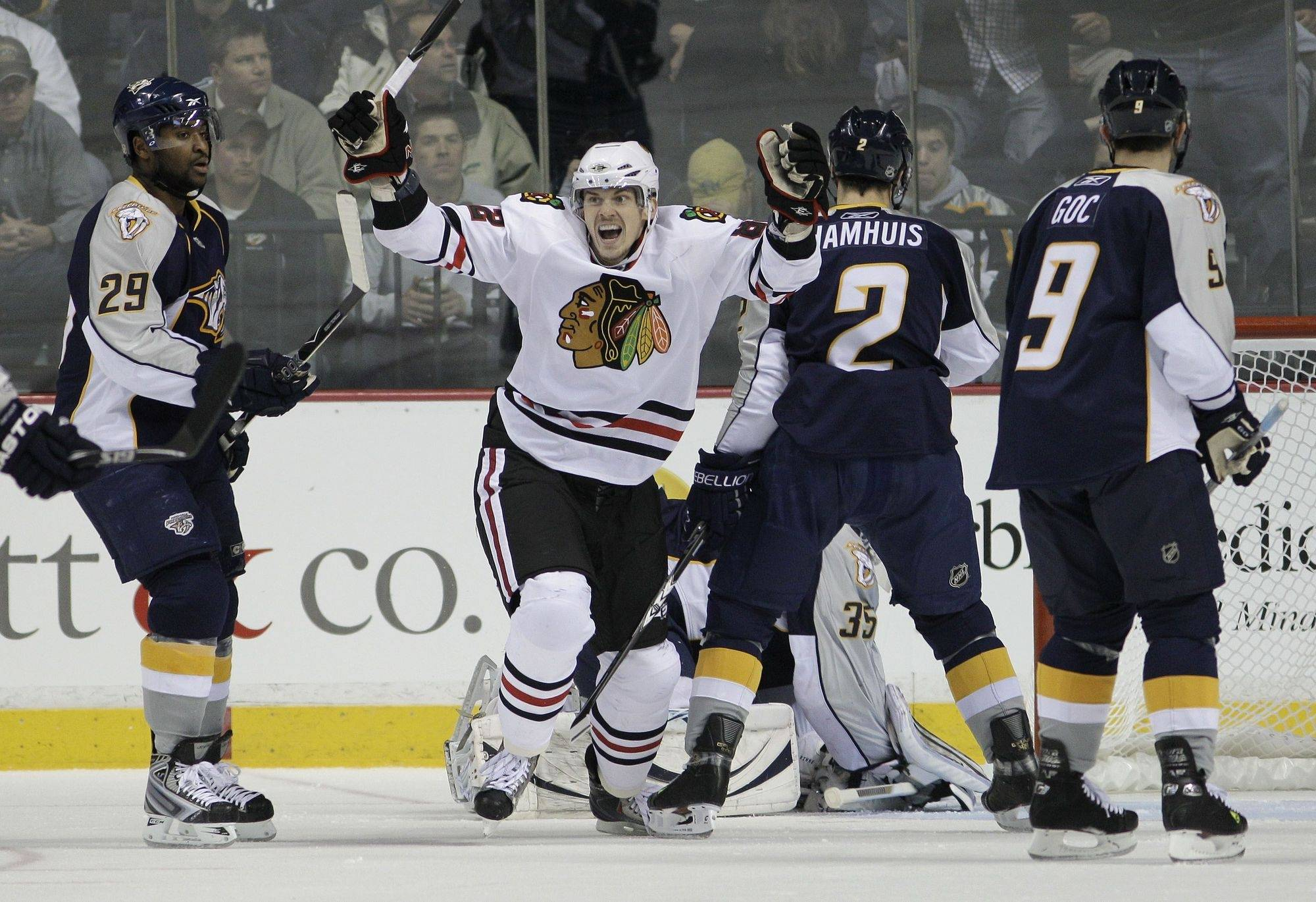 Chicago Blackhawk Tomas Kopecky, center, celebrates a goal by teammate Duncan Keith, not shown, during the first period. Defending for the Predators are Joel Ward (29), Dan Hamhuis (2), and Marcel Goc (9).