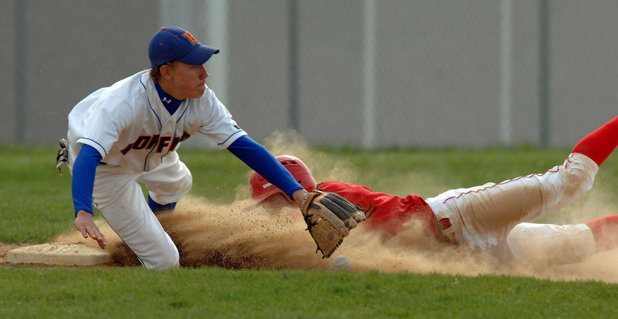 Hoffman Estates' Trent Rehusch covers third after Palatine's Cody Bobbit slides in for a triple during Monday's game.