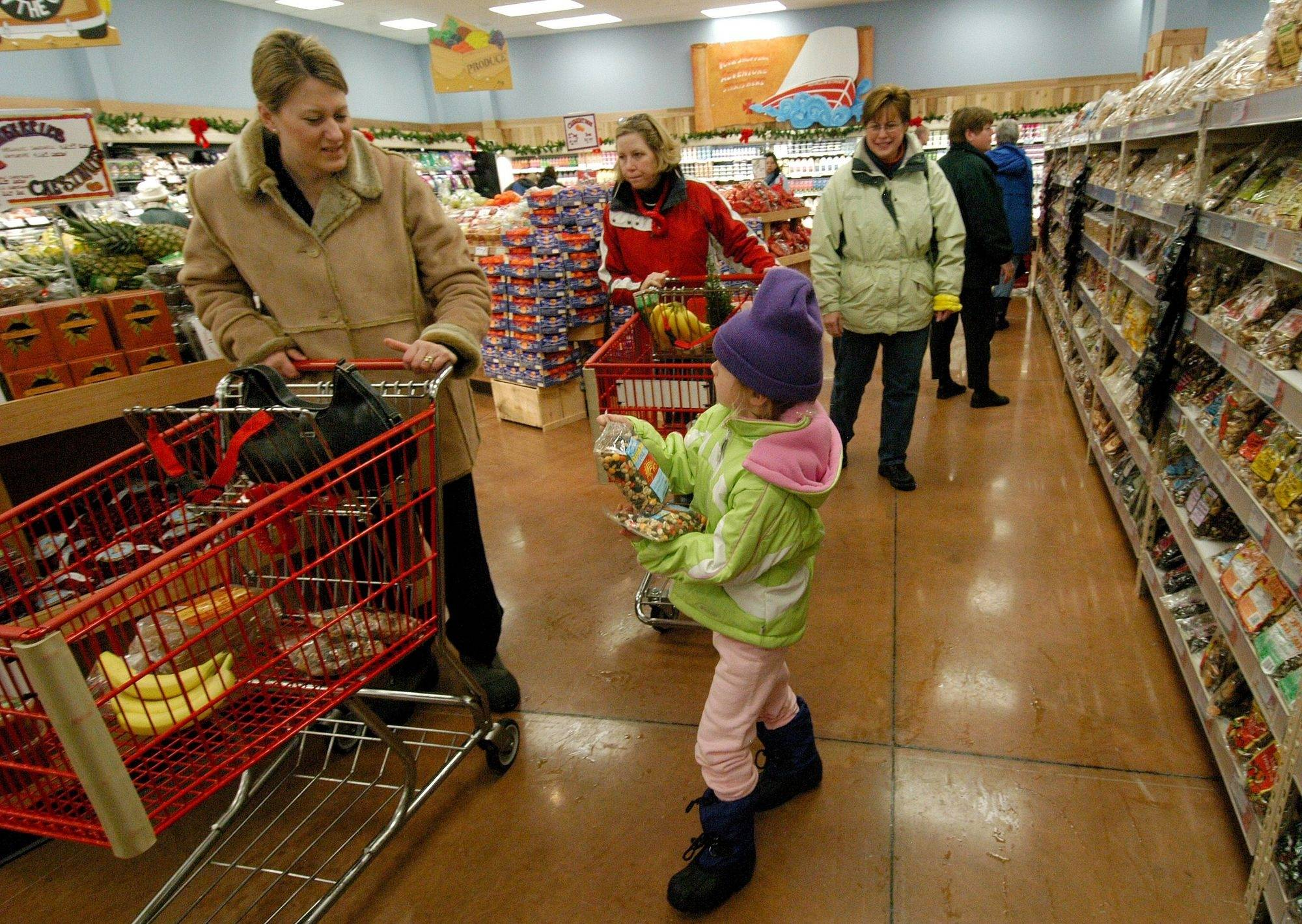 Customers shop in the Algonquin Trader Joe's store. Libertyville is looking into the possibilities of getting a store.