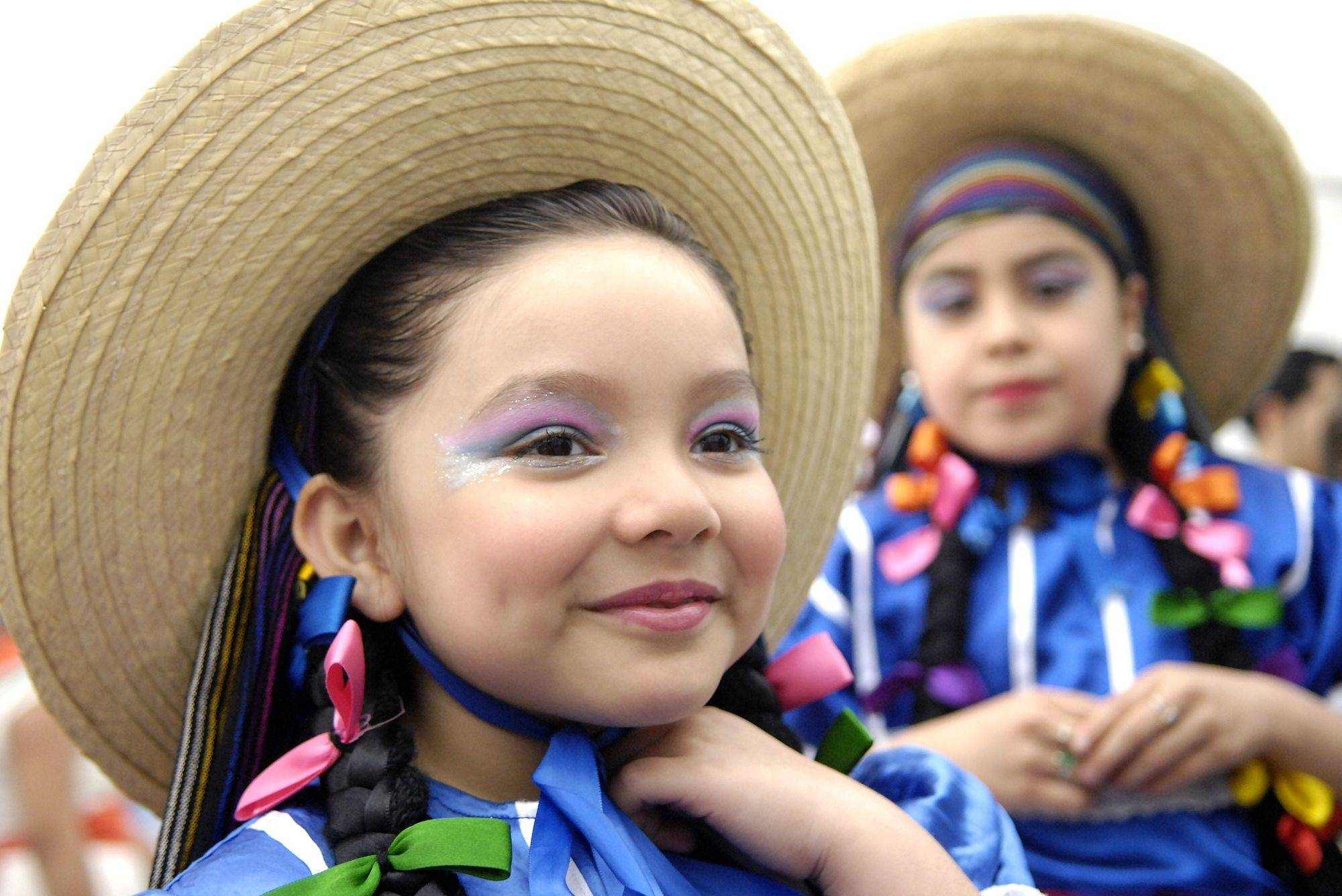 Jocelyn Celaya, 5, of Aurora waits for her group to perform at the El Dia los ninos (The Day of the Children) event in Aurora on Saturday, April 25. Jocelyn is with the Mexican dance ensemble Ballet Folklorico Quetzalcoatl and just took up dancing three months ago.