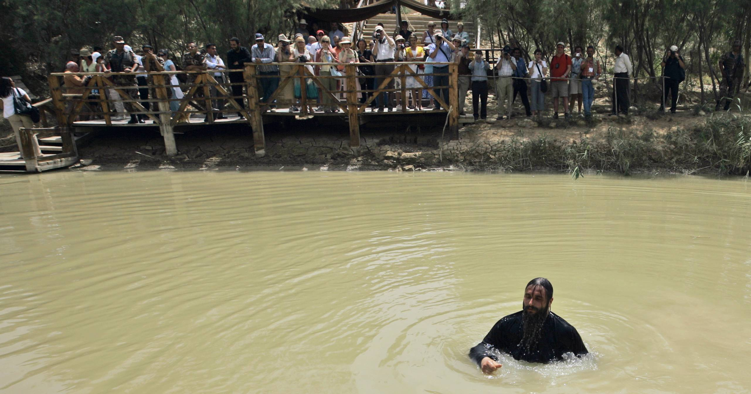 A Greek Orthodox priest bathes in the Jordan River after it was blessed during a baptism ceremony at Qasr-el Yahud near Jericho, in the West Bank.