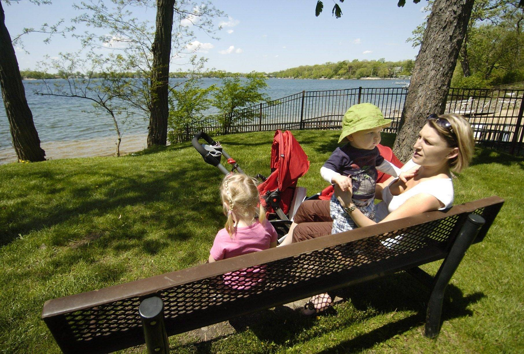 Lidia Grigaraviciene of Lake Zurich, with her daughter Greta and neighbor Tyler Kimes, spends a lot of time with her family at Breezewald Park in Lake Zurich because it's walking distance from her home and it's free.