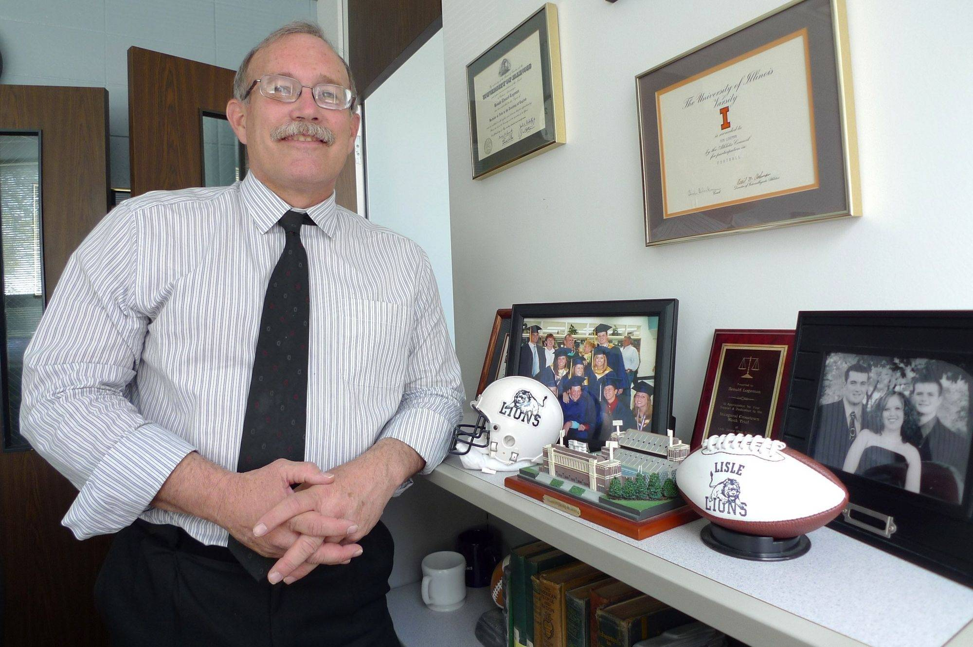 "Ron Logeman is preparing to step down after 26 years as principal at Lisle Senior High School. ""It probably will be a little harder than I think to walk out the door,"" he says."