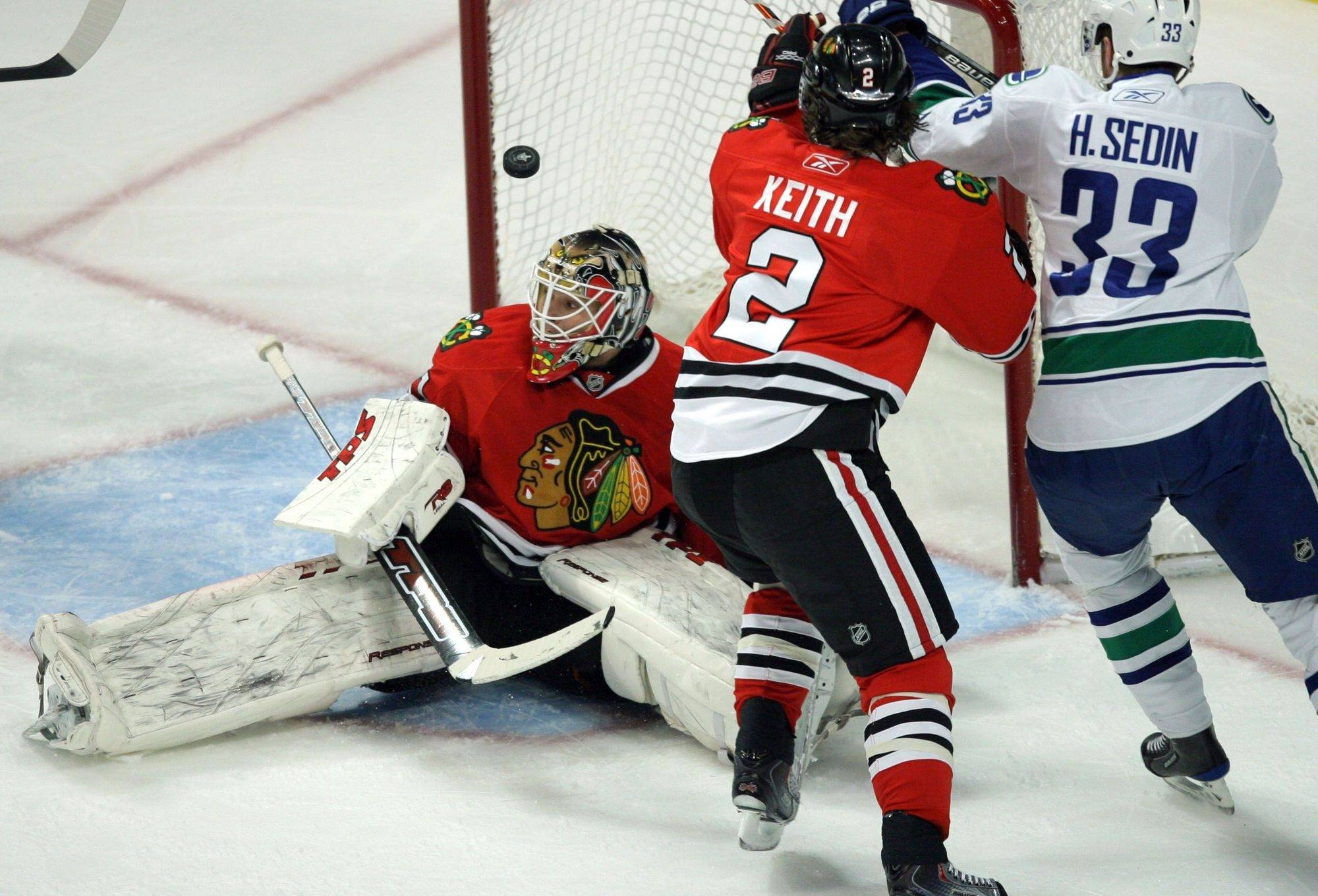 The Blackhawks' Antti Niemi watches the the puck go into the net during the first period.