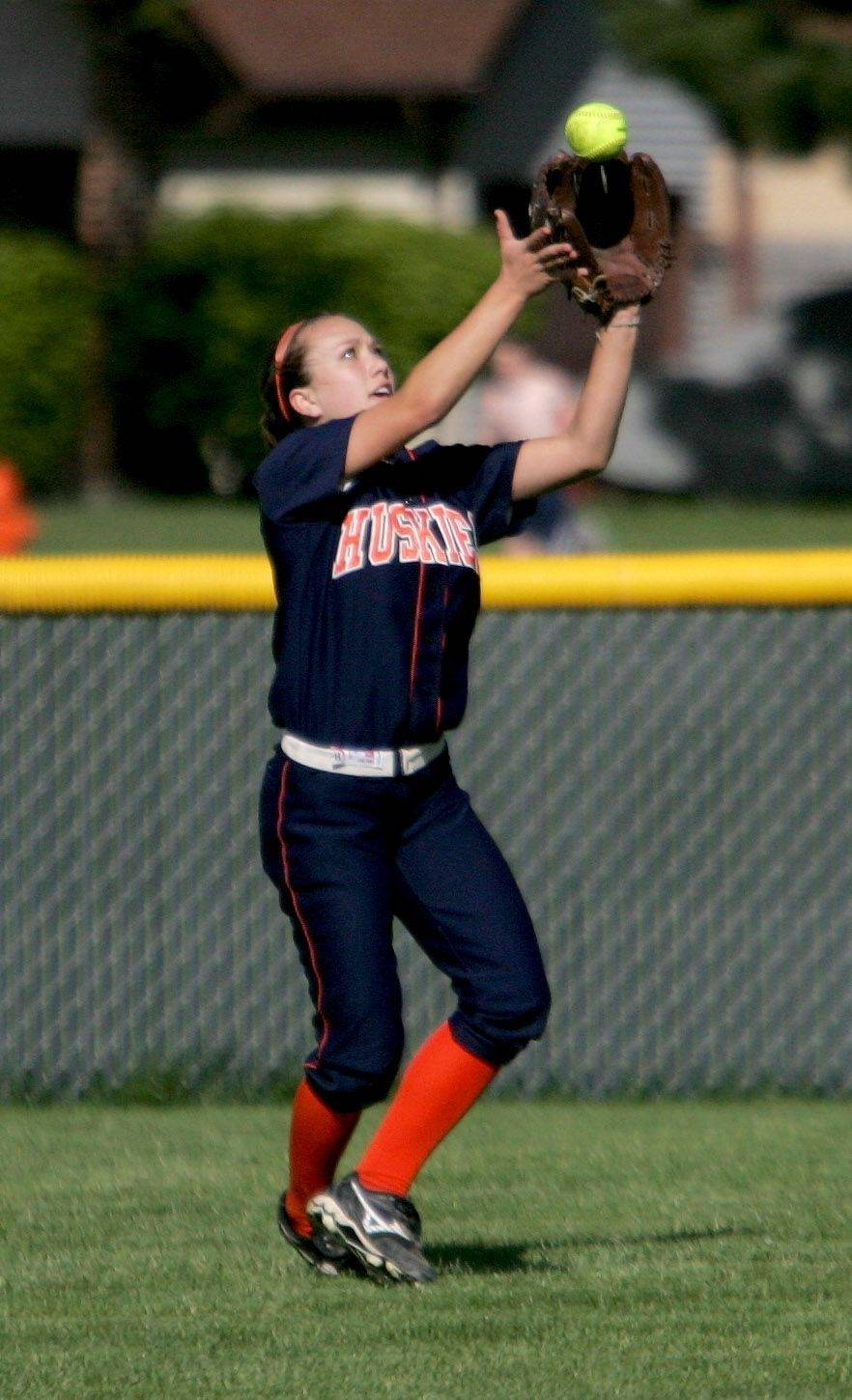 Caitlyn Warren of Naperville North makes a catch in the outfield against Naperville Central during Monday's softball game.