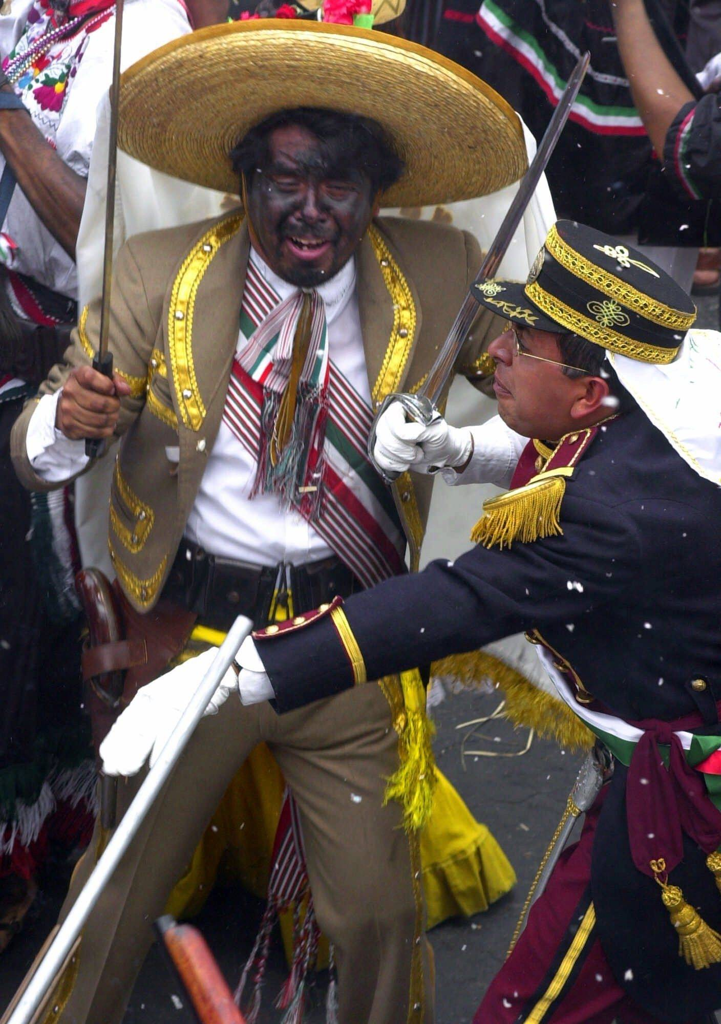 Penon de los Banos residents celebrate Cinco de Mayo with a reenactment of the 1862 battle between the French and the Zacapuaxtlas Indians Saturday, May 5, 2001, in Mexico City.