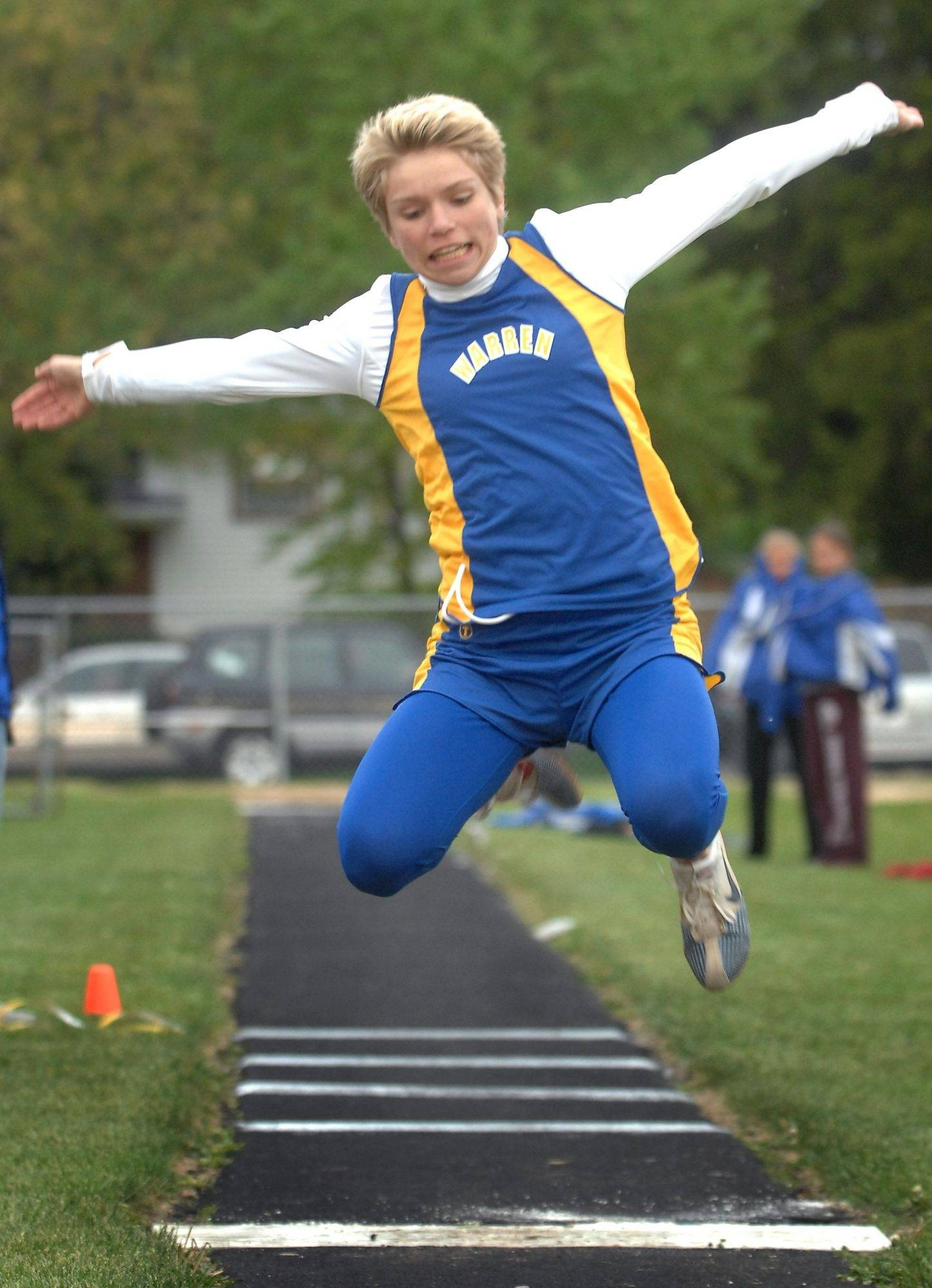 Warren's Amber Cook competes in the triple jump event at the North Suburban Conference track meet Thursday in Mundelein. Cook won the event.