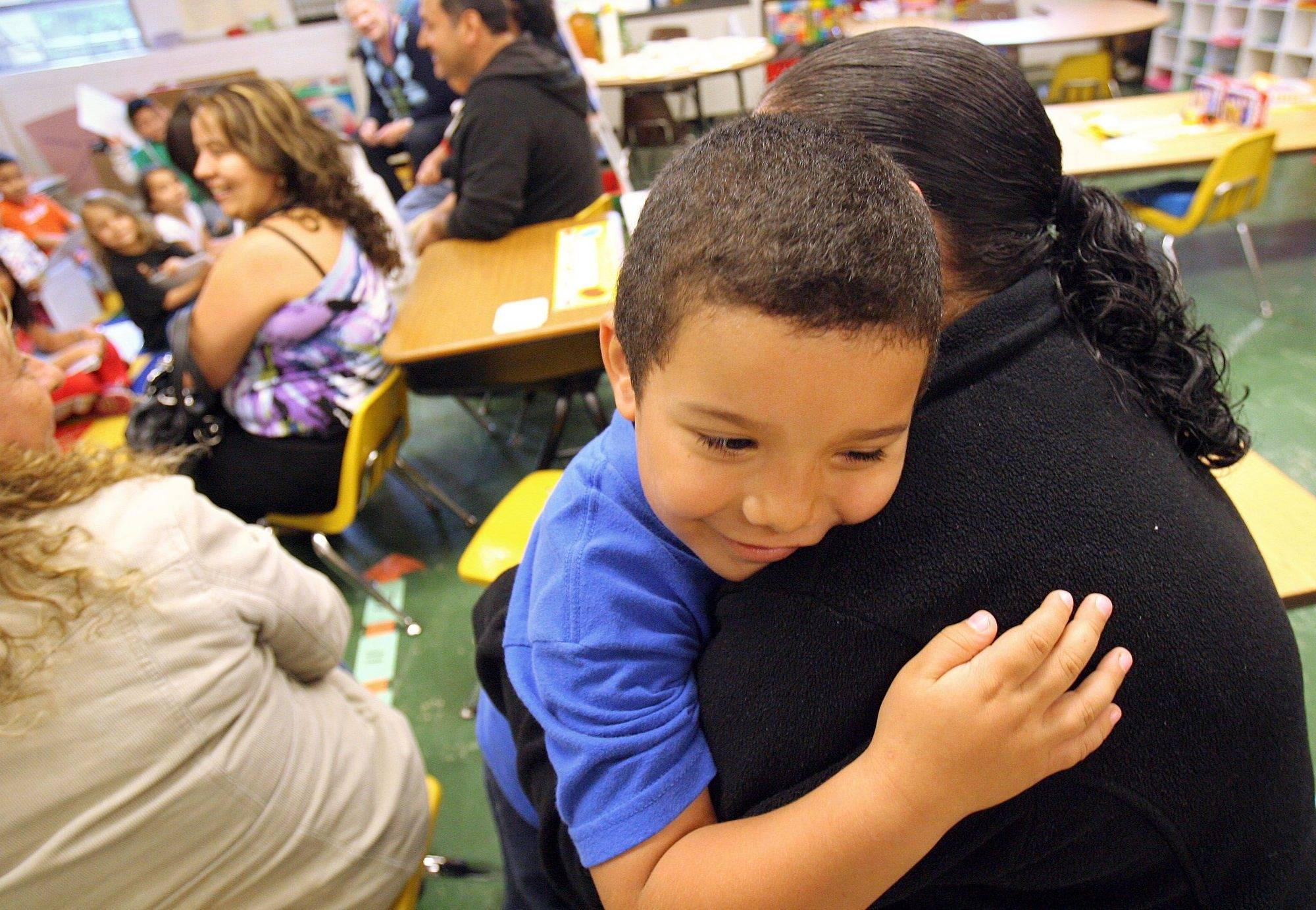 Jose Gonzalez of Mundelein is so happy his mother, Maria, came to the Fairhaven School Mother's Day tea party Friday.