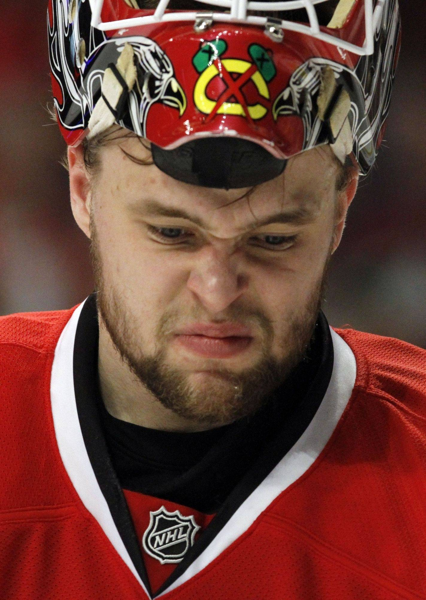 Chicago Blackhawks goalie Antti Niemi reacts as he looks down during the first period of Game 5 of an NHL hockey Western Conference second-round playoff series against the Vancouver Canucks Sunday, May 9, 2010, in Chicago.