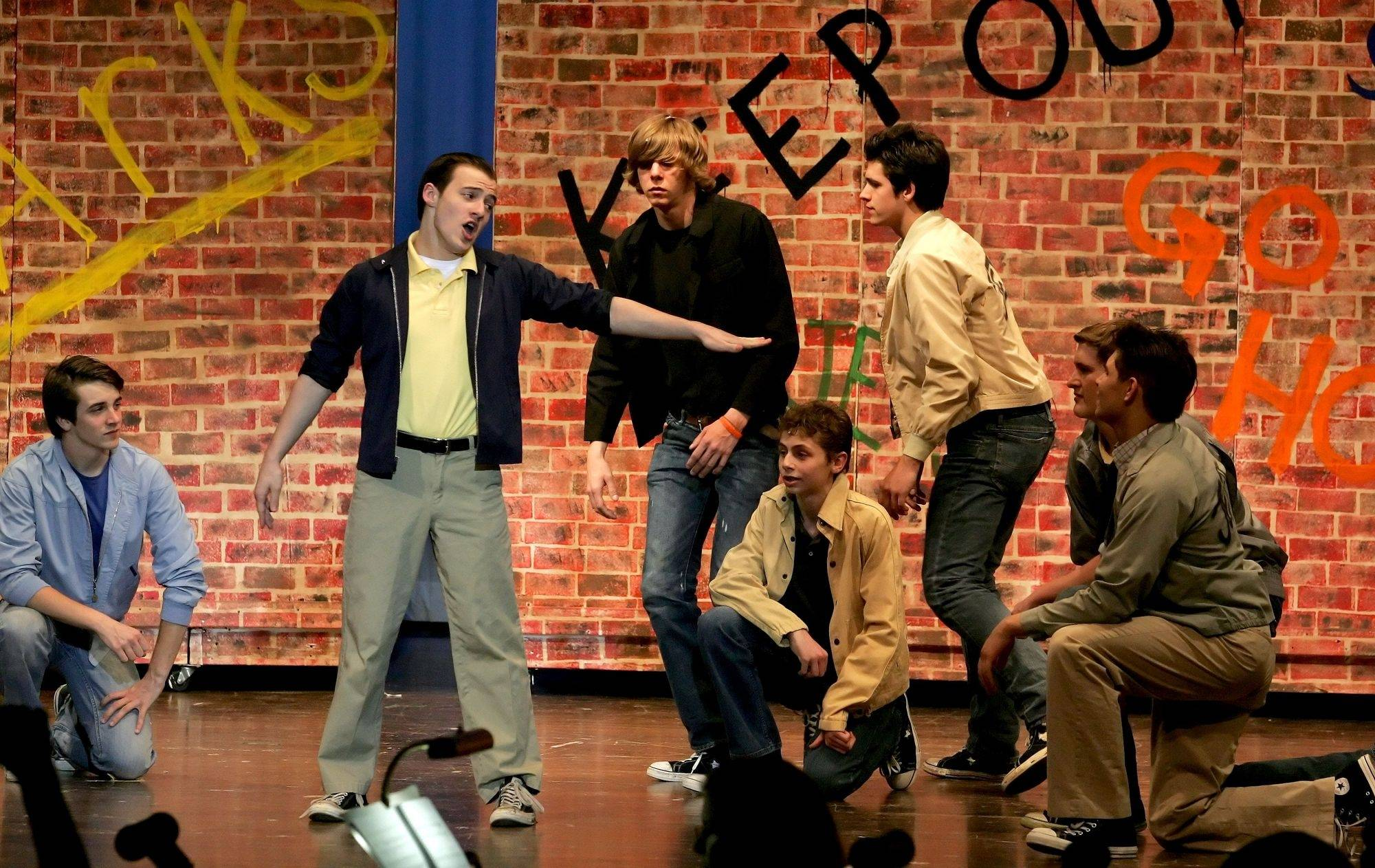 "Jeff Pierpoint sings a number with the other Jets in rehearsal of ""West Side Story"" at West Chicago's Community High School."