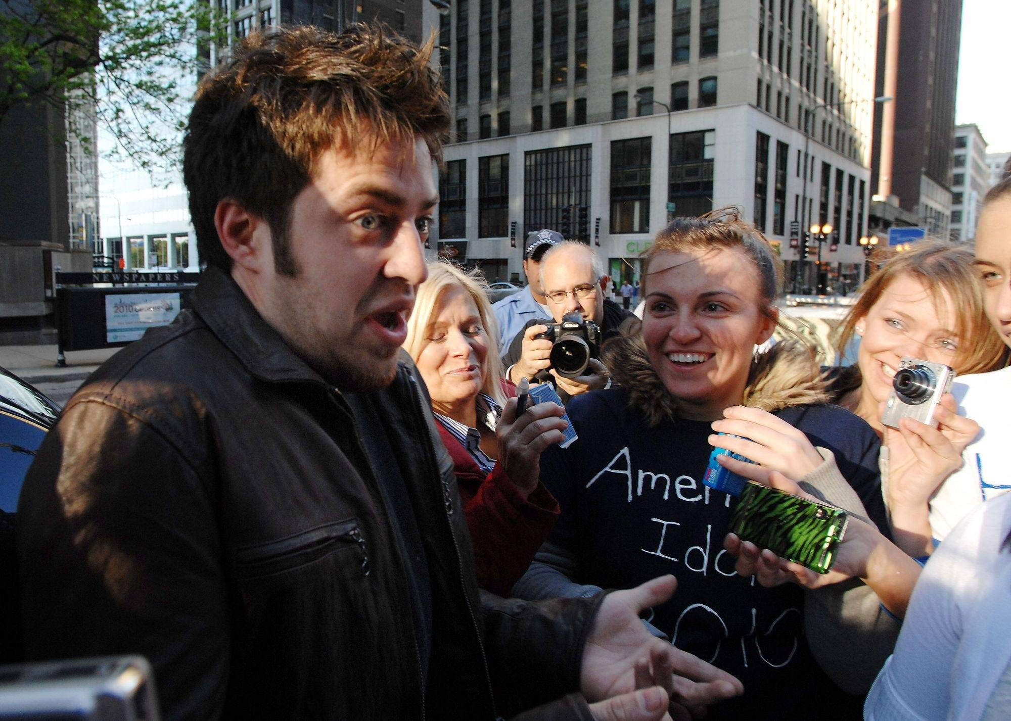 Lee is shocked by the fan reaction as he is greeted by his fans outside the Fox 32 Studios in Chicago.