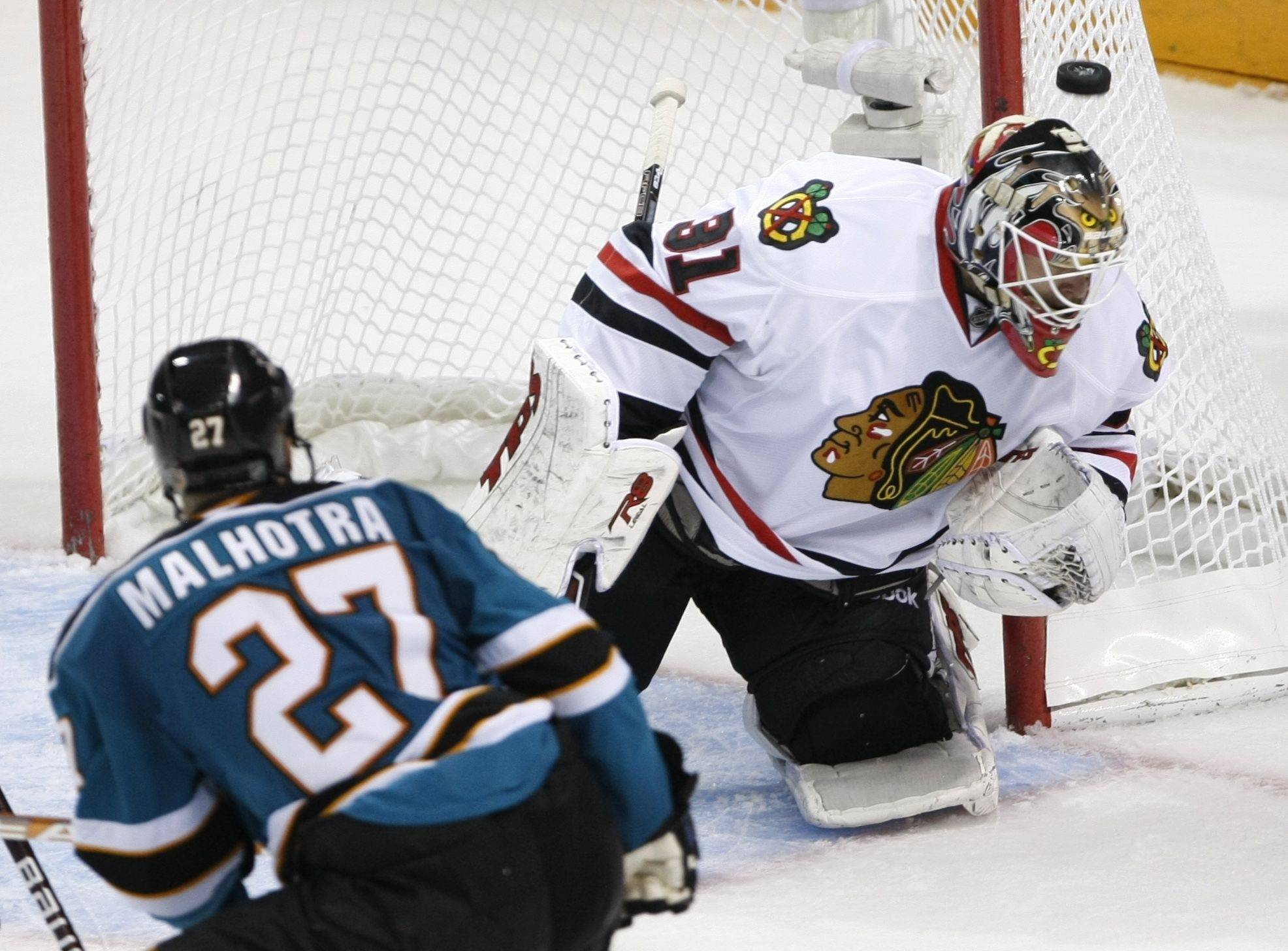 Chicago Blackhawks goalie Antti Niemi blocks a shot by San Jose Sharks center Manny Malhotra during the second period of Game 1 of the NHL hockey Western Conference finals, Sunday.