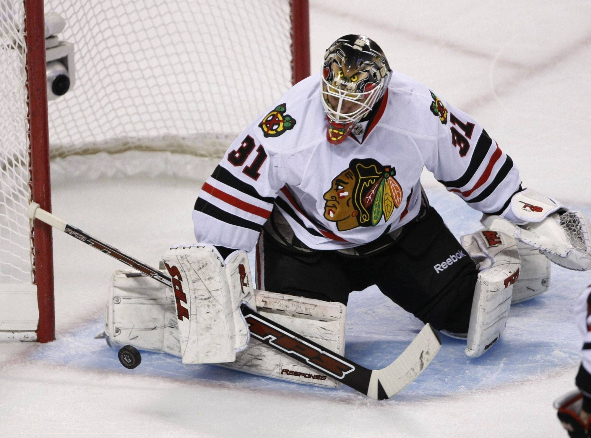 Chicago Blackhawks goalie Antti Niemi blocks a shot by a San Jose Sharks player during the first period.
